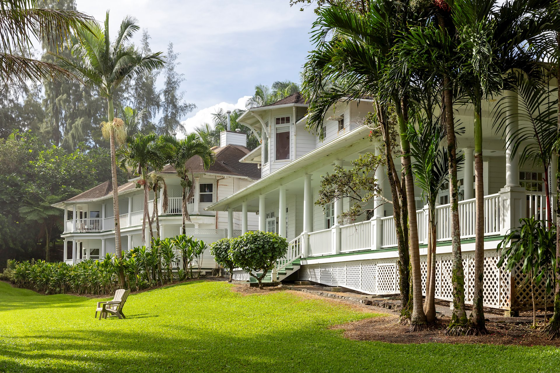 Palm trees and expansive lawns surround the estate.