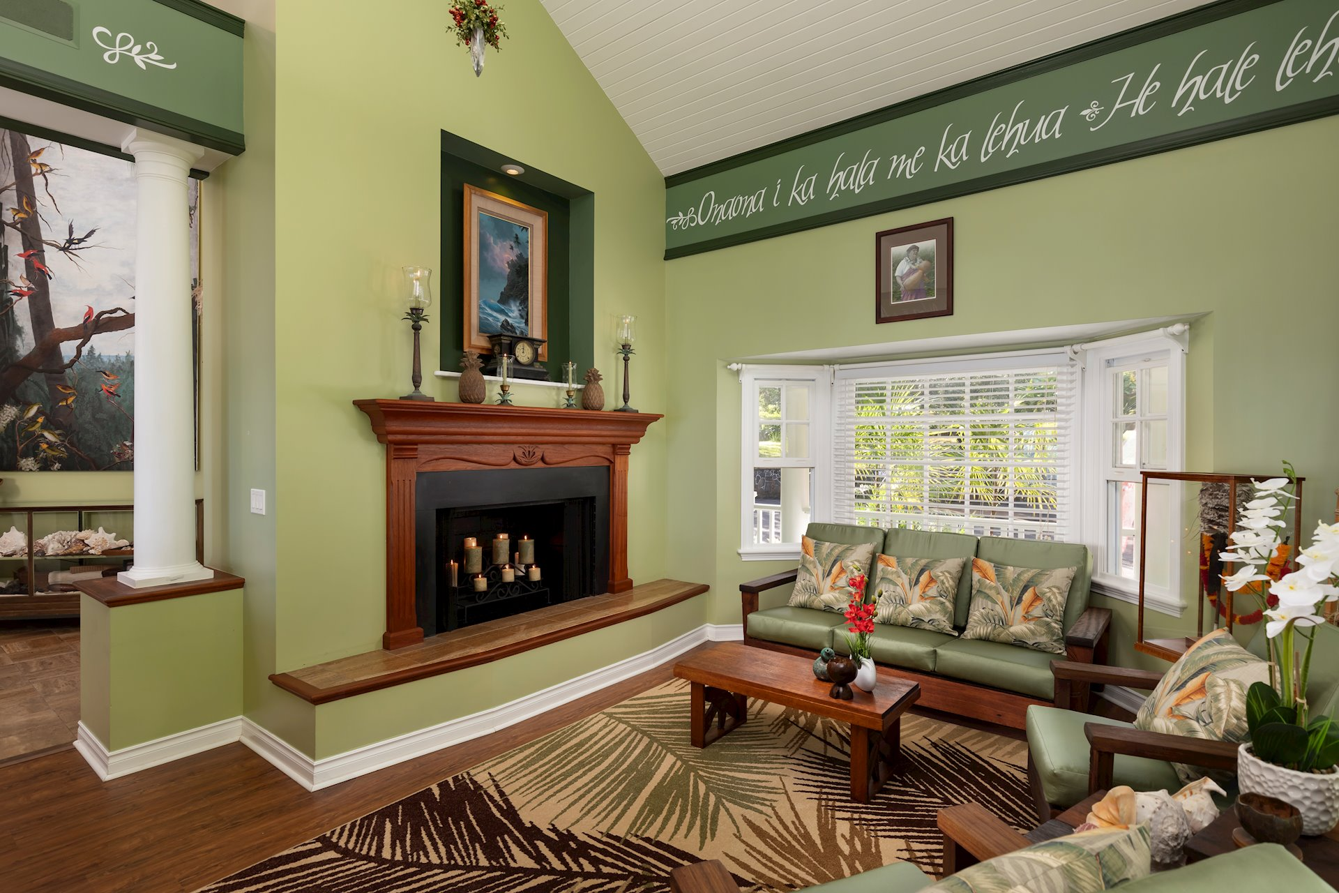 The Living Room with fireplace and patinaed wood flooring.