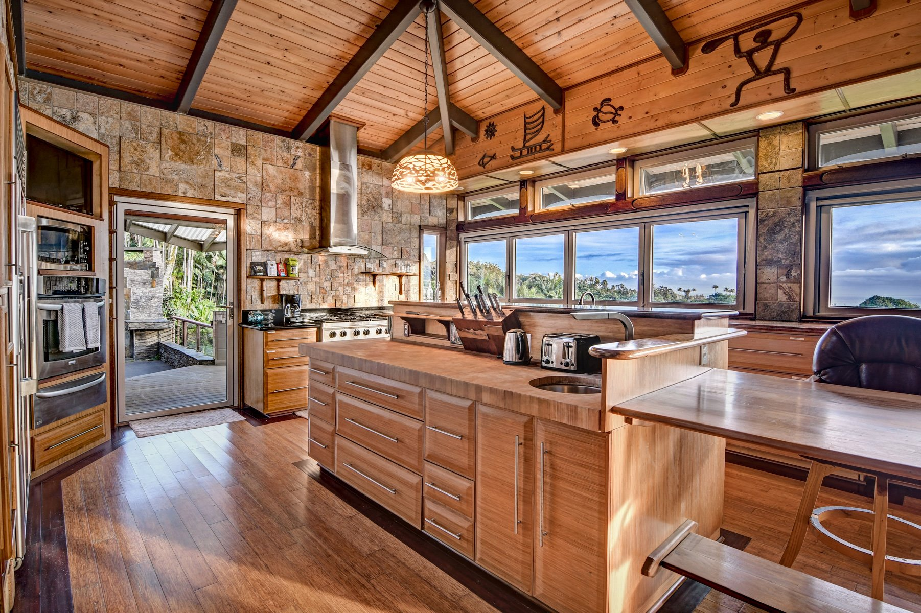 Kitchen includes a custom ordered 6' under-mount sink with drainboard, sliding collander, and sliding chopping block, 2-12' banks of Nana Windows that open the kitchen to the breathtaking bay and ocean views