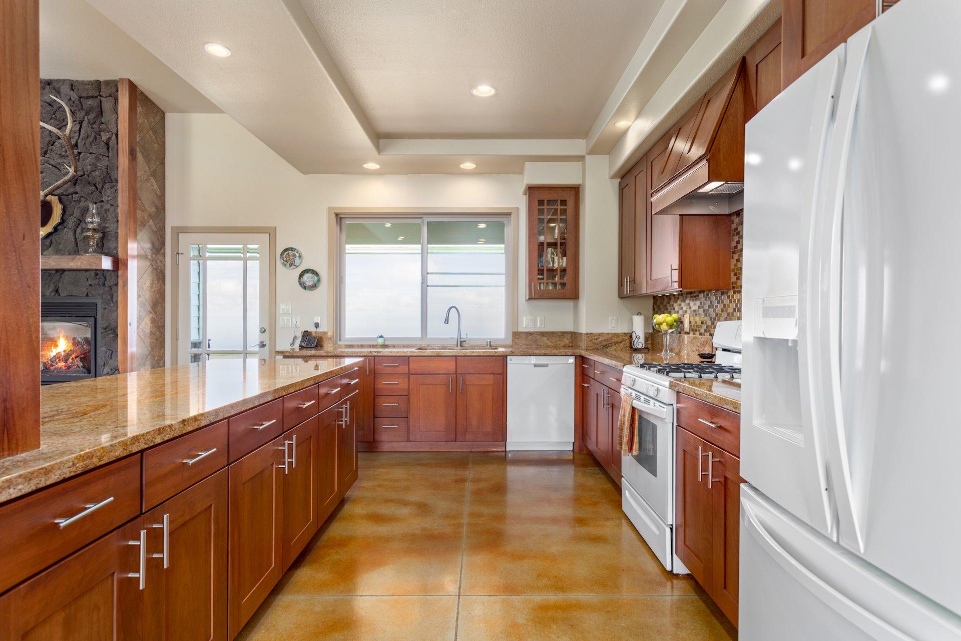 Modern kitchen with pass through window to the lanai