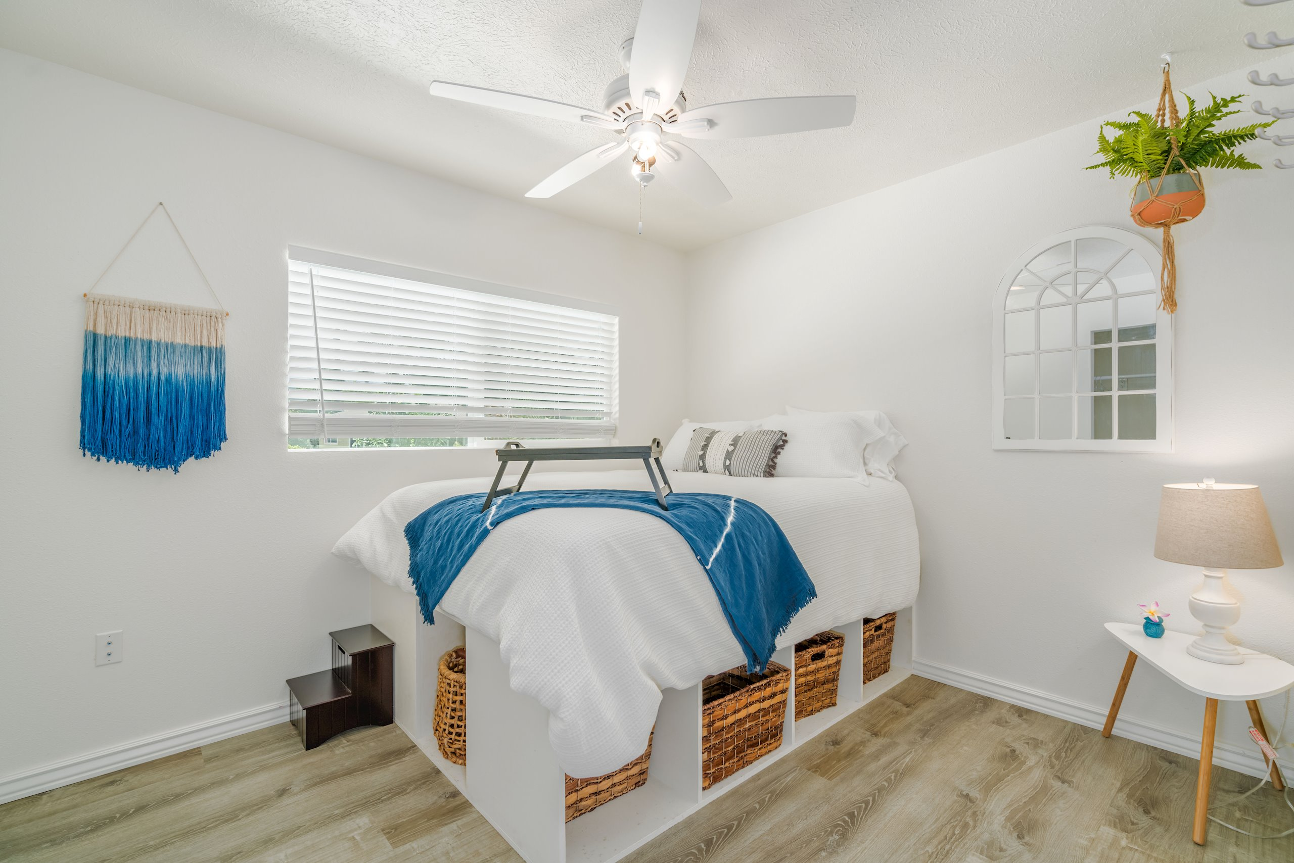 """Another guest bedroom upstairs. High quality """"LifeProof"""" grey-toned wood plank laminate throughout the entire house"""