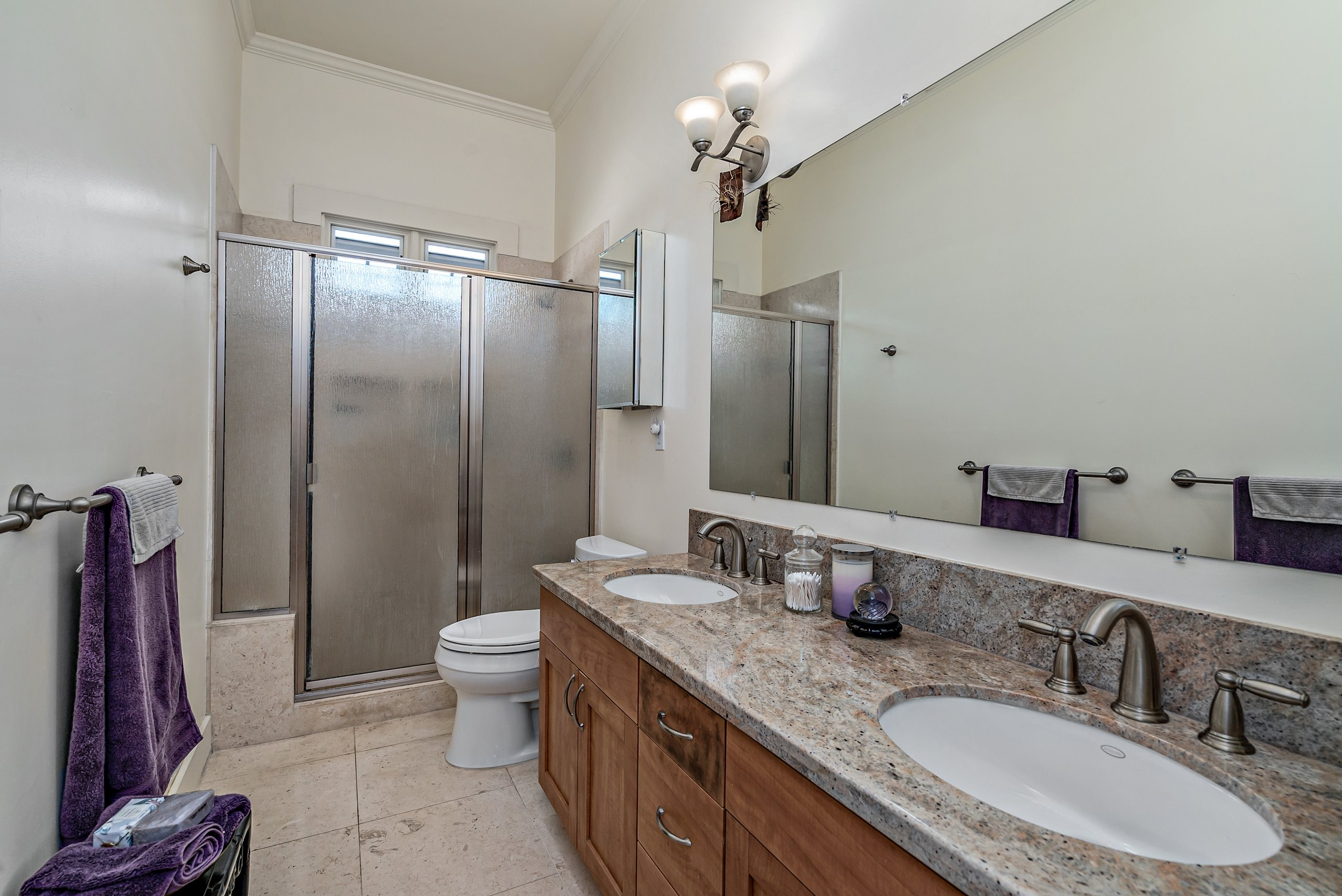 Travertine Hall bath shared by two bedrooms