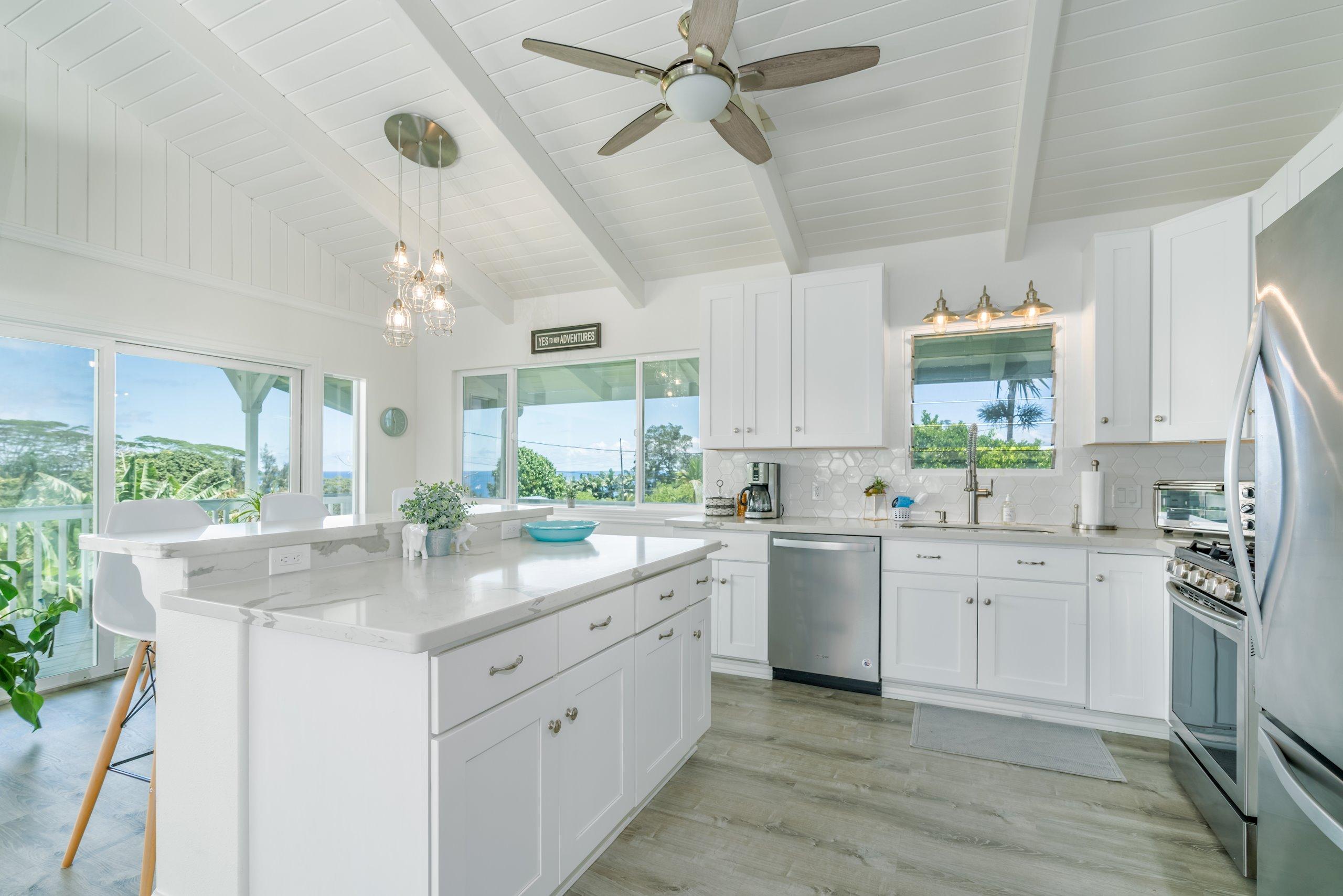 Brand new custom white cabinets, modern off white honeycomb backsplash, off white grey vein quartz countertops, double wide kitchen sink, brand new top of the line appliances.