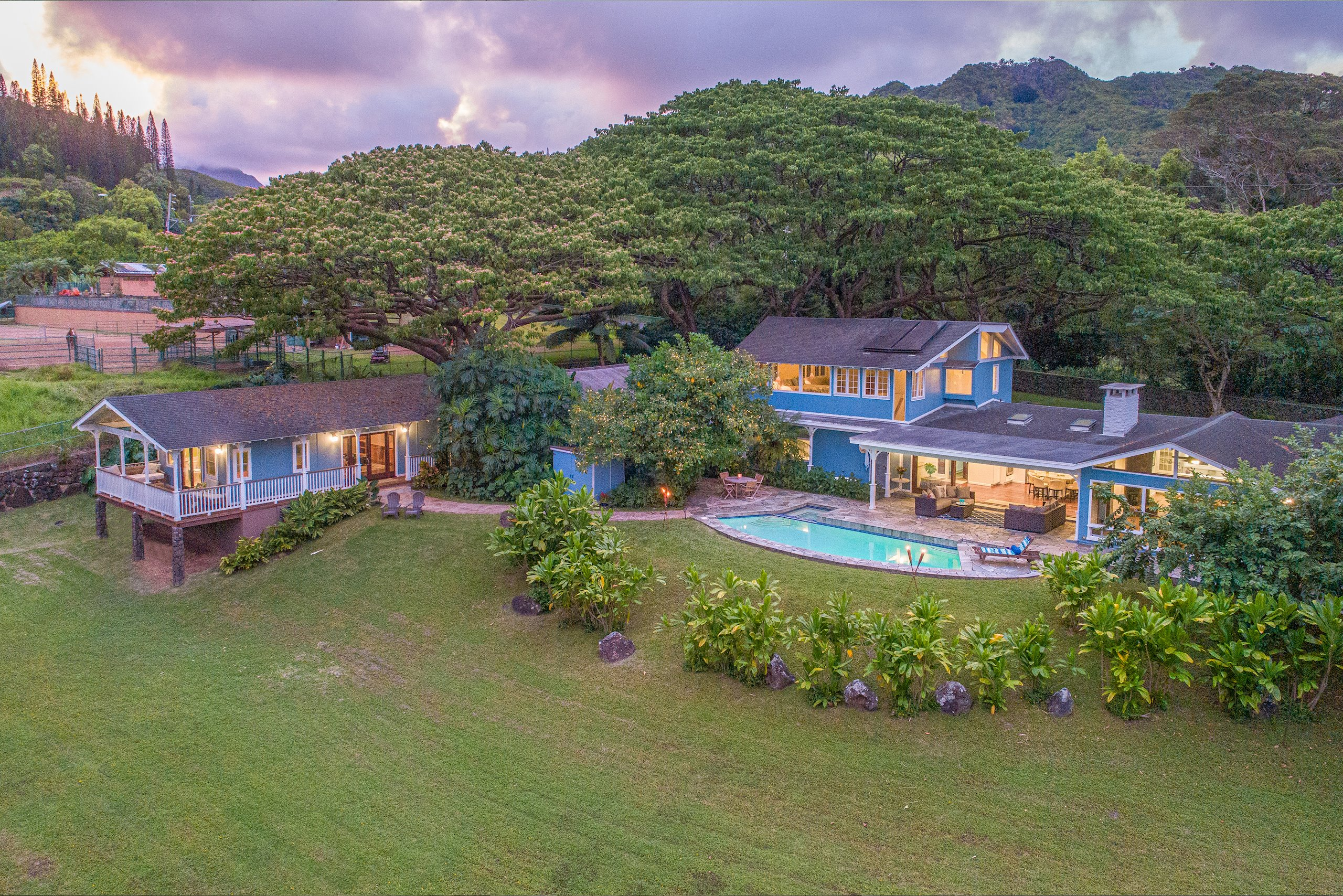 Unique Maunawili 4 BR estate situated on over an acre, zoned country. Main living area opens onto a covered lanai overlooking the pool & the rolling lawn surrounded by tropical landscaping. Remodeled & expanded in 2015, the kitchen features stainless appliances & an expansive island. On one side of the kitchen is a game room & on the other, the living room w/fabulous mountain views. 3 BRs & a bath are beyond the living room. Upstairs is the spacious private master suite w/gorgeous views of Mt Olomana. Past the pool, is the guest cottage built in 2011, w/a bedroom, bathroom & living area, & a covered lanai enjoying the mountain views & breezes. As quiet & private as the home feels, it is a short drive to Kailua-town, Kailua's Beaches & an easy hop to the Pali or H-3 to head to Honolulu.
