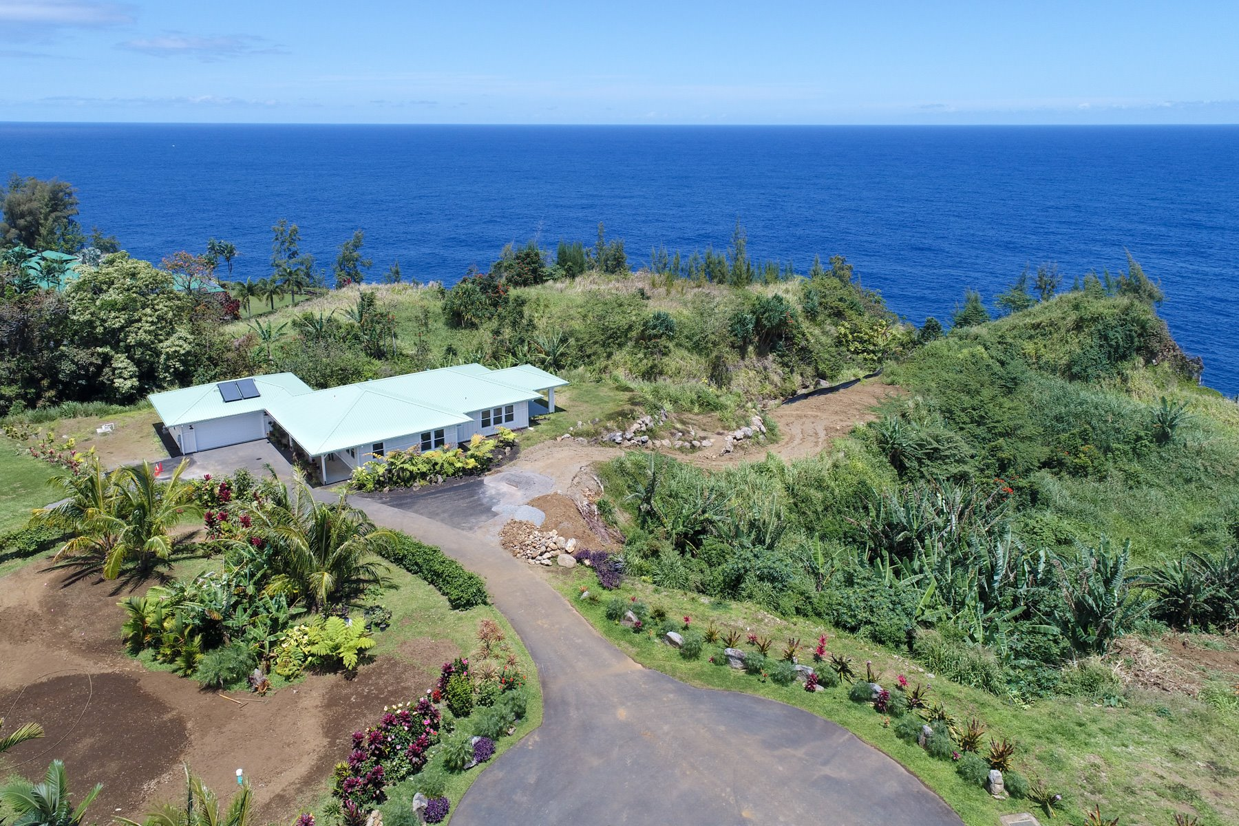 Panoramic ocean views from this home located in the beautiful and peaceful Ninole town