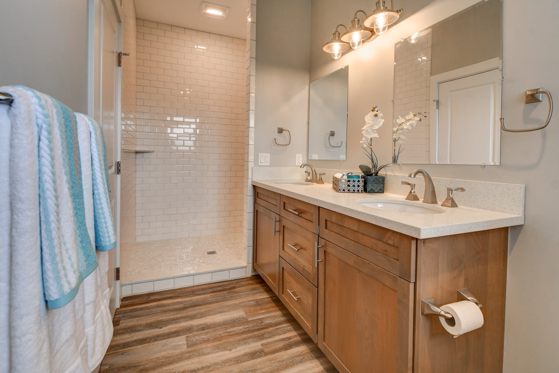 Double sinks master bath and oversized, floor to ceiling tiled walk-in shower.