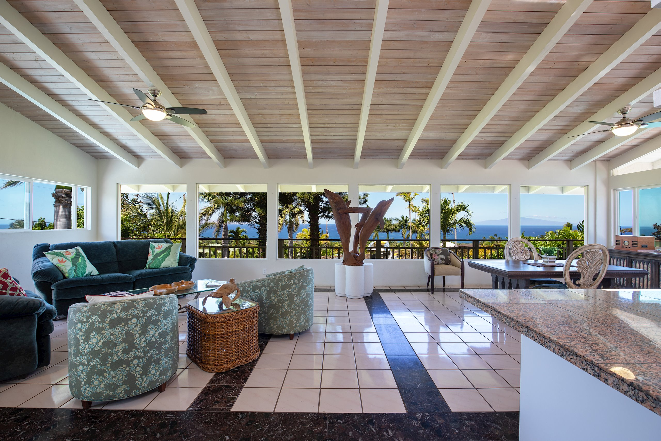 This is the best value in Maui Meadows when you consider it offers 3990 sq ft of permitted living space on a flat, half acre lot in Maui Meadows. And let's not forget the views from every floor of the house. The 180+ degree panoramic ocean views can be enjoyed from both the first and second level, or take it up the rooftop lanai for sunsets and cocktails with spectacular 360 degree views in every direction.  The property is ideally suited for someone looking for rental income or for an extended family. The main residence on the 2nd floor offers a private entrance, open bean ceilings and marble flooring representative of Mediterranean style homes, along with a wrap around lanai to enjoy the big ocean views.  The ground floor is divided into two living areas - a 2br/1ba ohana with ocean views and 1br/1ba suite. Each has it's own separate entrance.  This private flat half acre property is surrounded by mature landscaping and an assortment of native and fruit bearing trees. It is only minutes away from the world renowned resorts, restaurants and the sandy beaches of Wailea and south Kihei. And did I mention the views?  Contact your favorite Realtor today to set up a private showing and see for yourself!