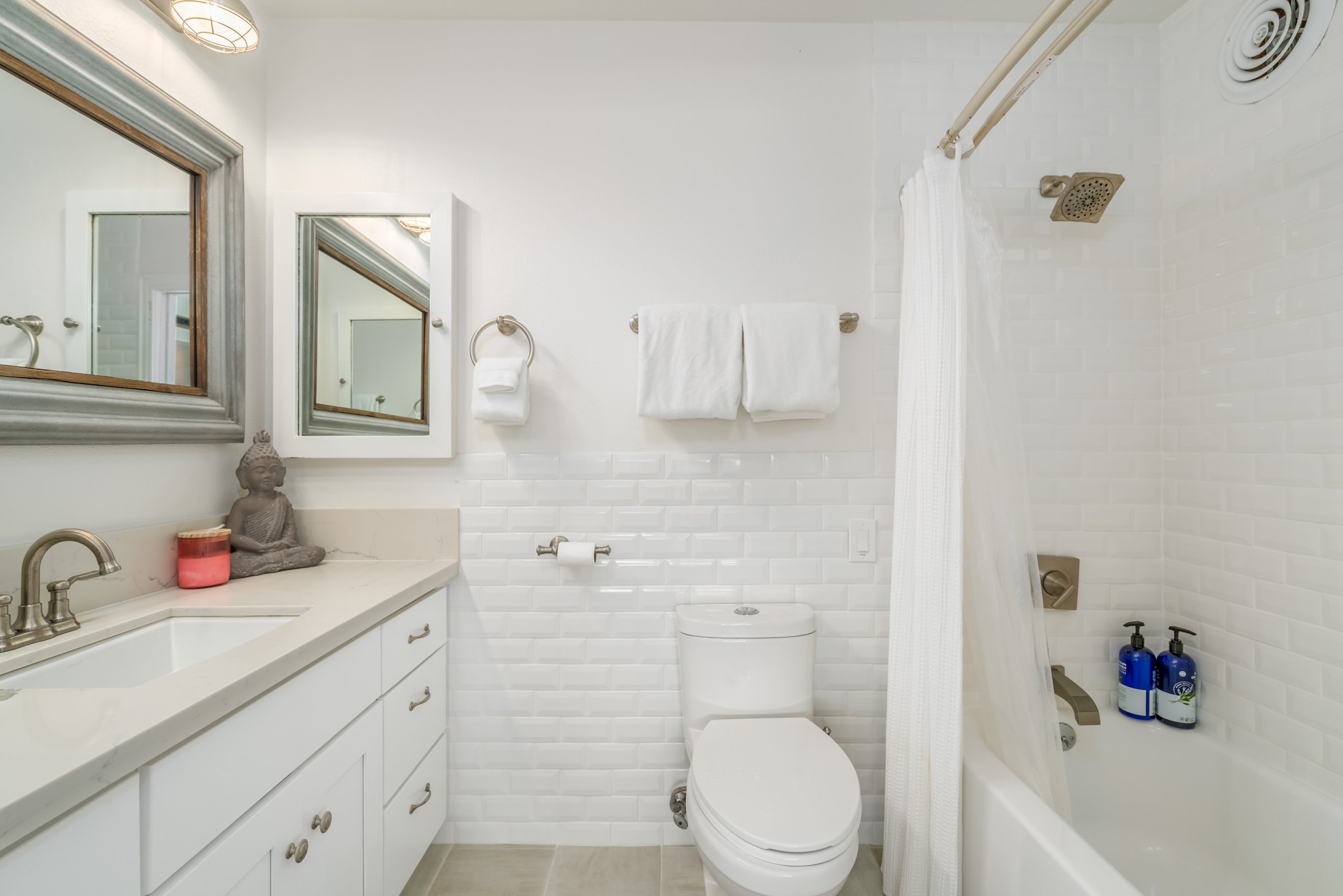 Custom tile work in all 3 bathrooms, off white Subway tile in master bath, pebble stoned showers.