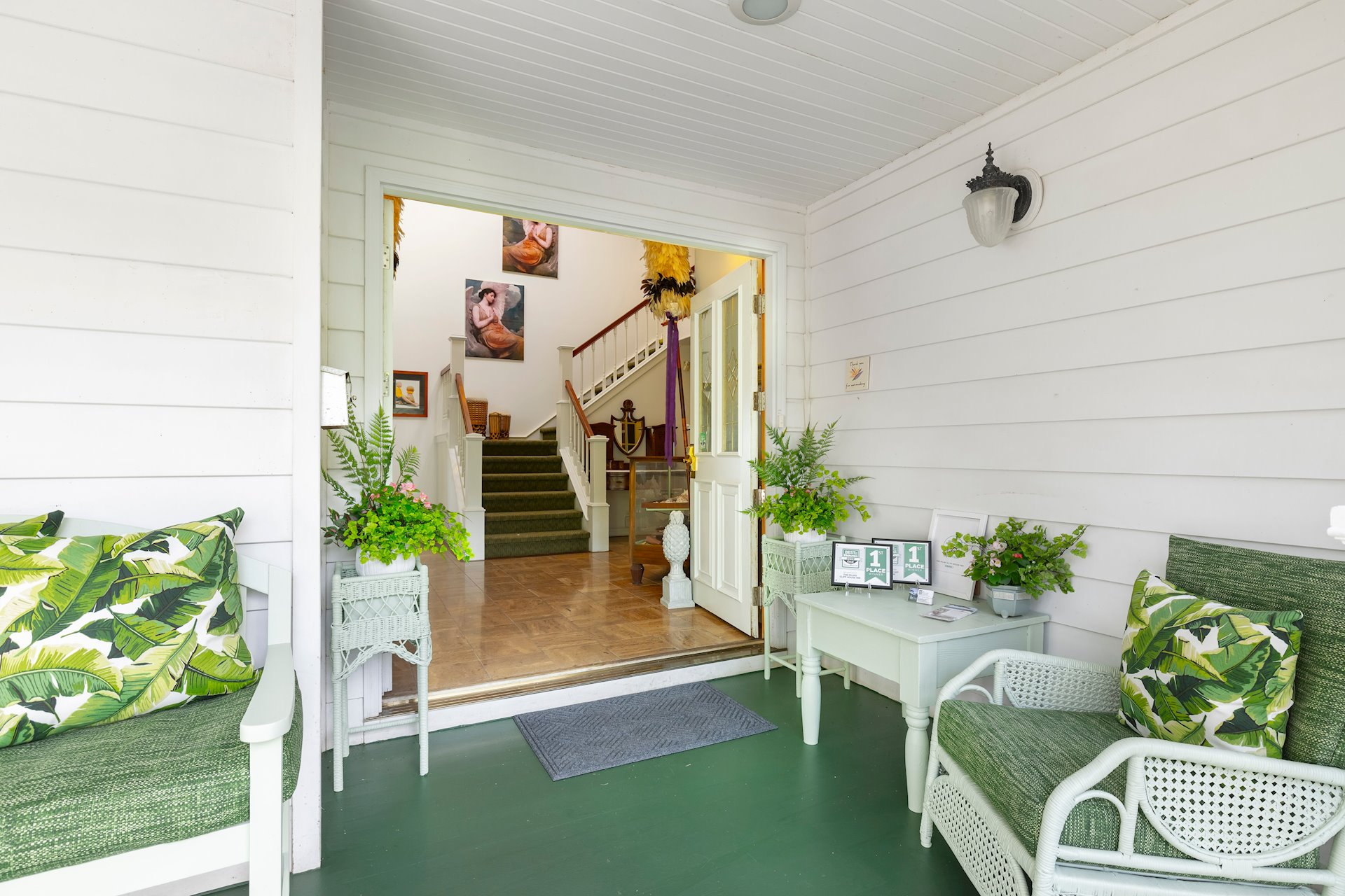 Front veranda beckons you into the foyer of the home.