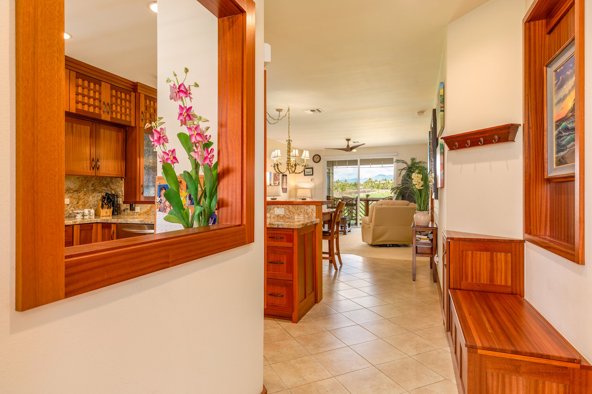 Entry with built-in storage bench and opening to the kitchen