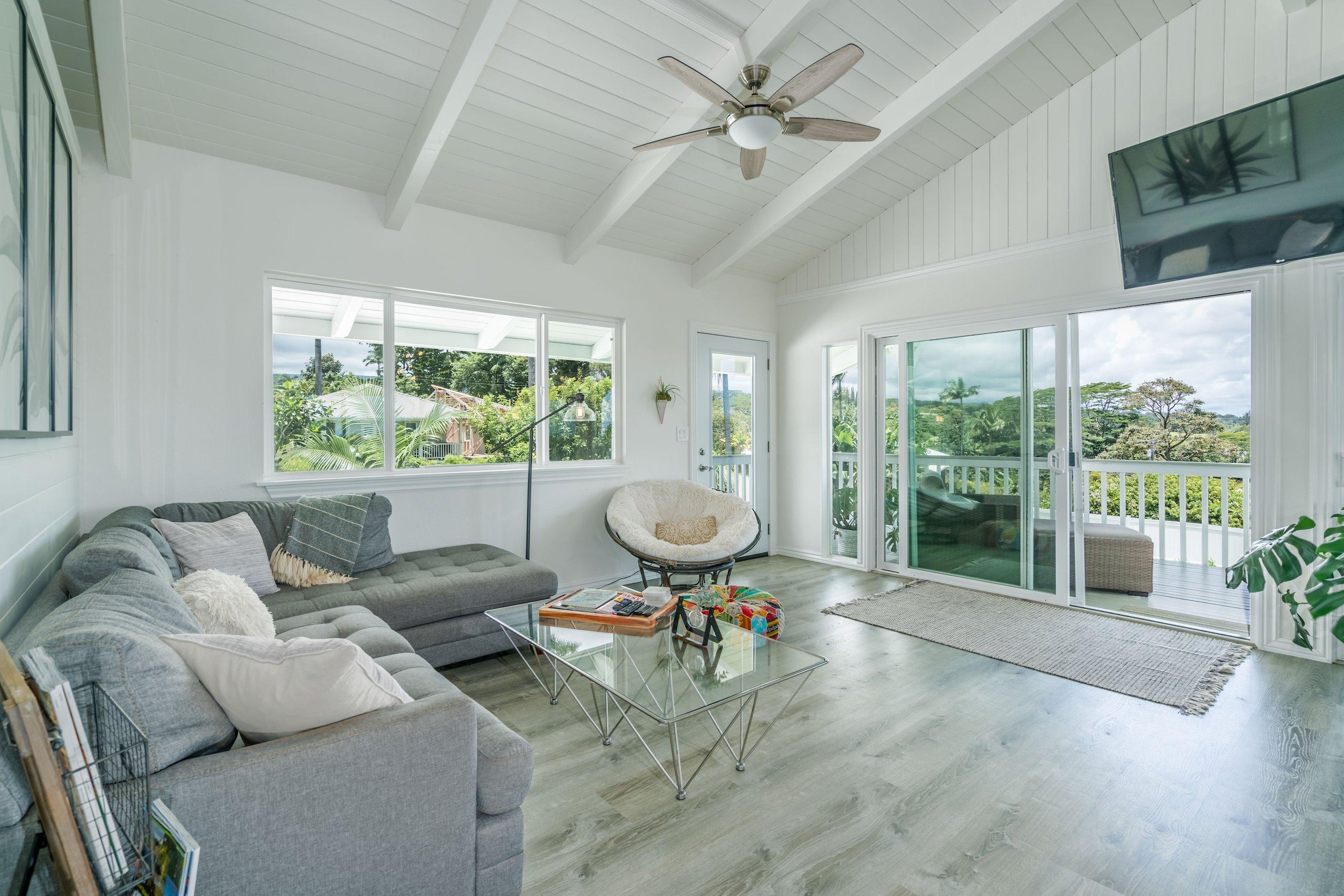 Gorgeous cool-white ship lap textured walls in the kitchen/entertainment room create a beachy farmhouse vibe.