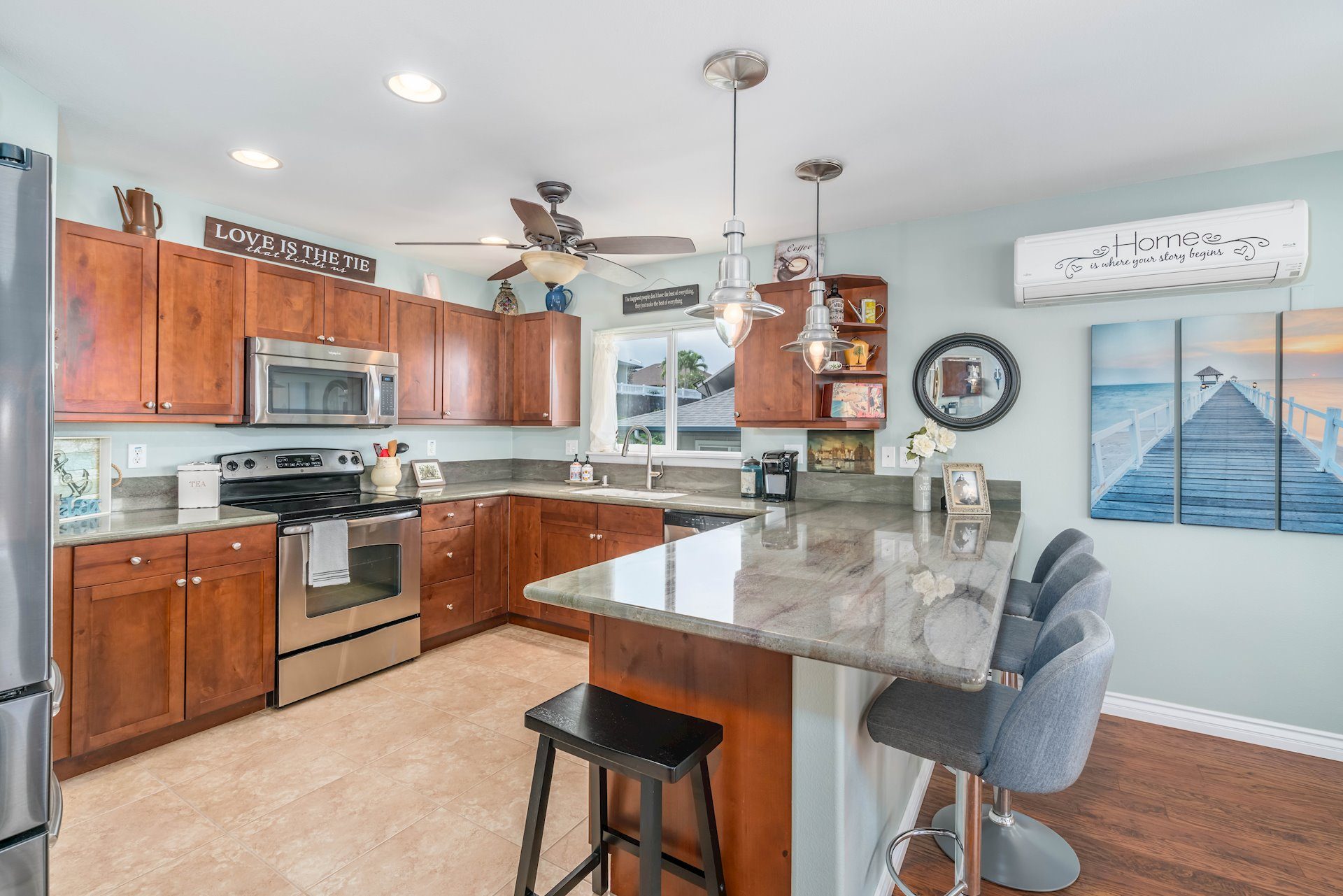kitchen with some upgraded appliances and granite countertops