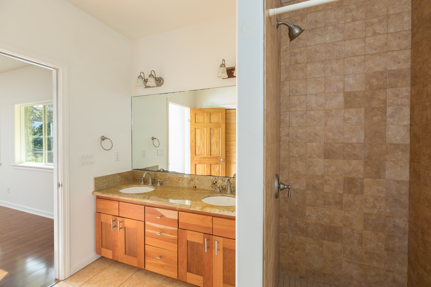 Wood floors, granite counter tops, 2 sinks in each bathroom and expansion potential.