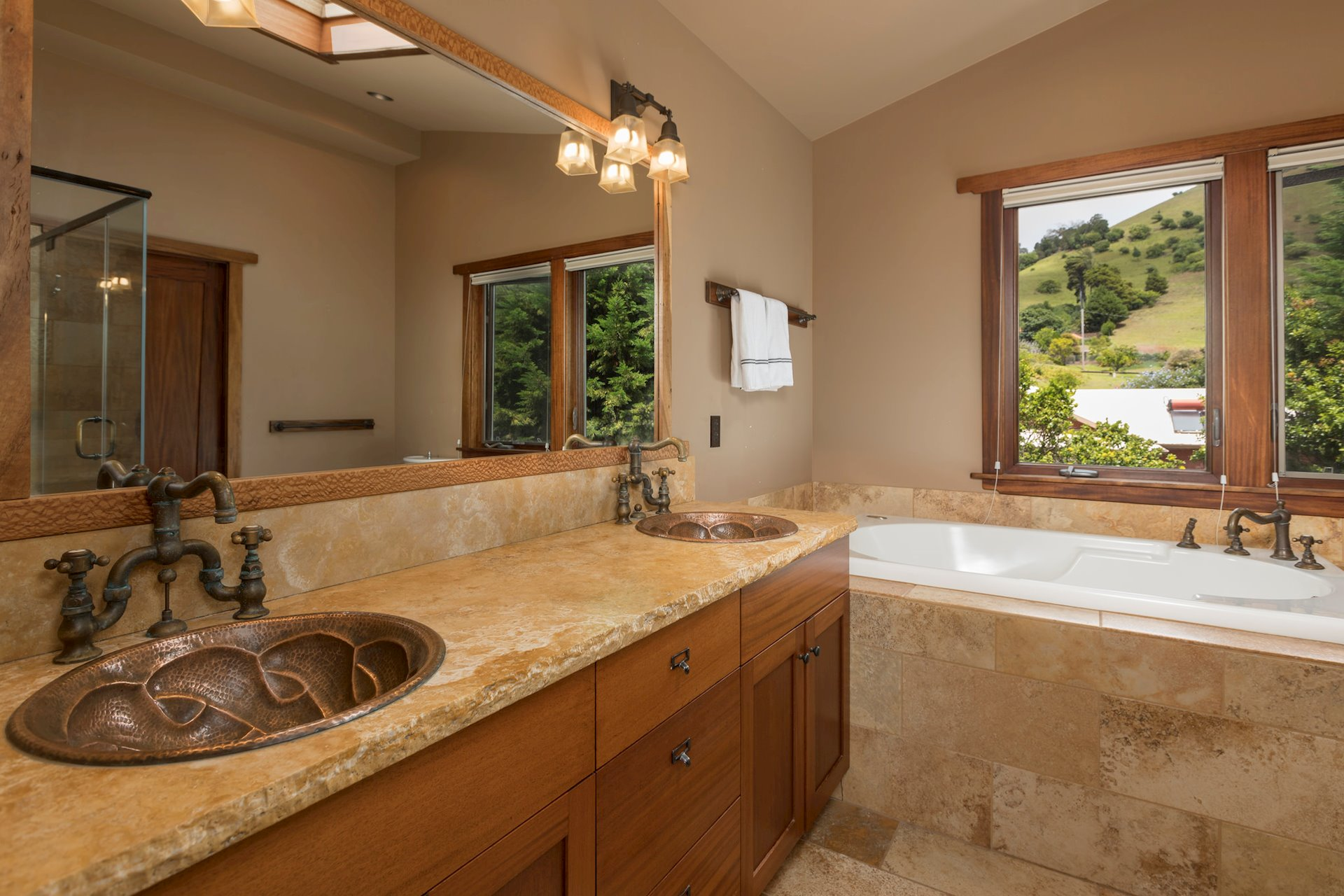 Master bath with double hammered copper sinks.