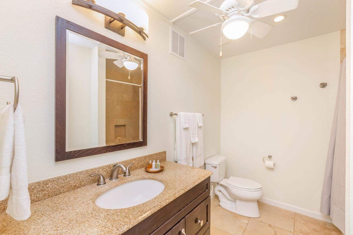 Bathroom with granite counter & travertine floors
