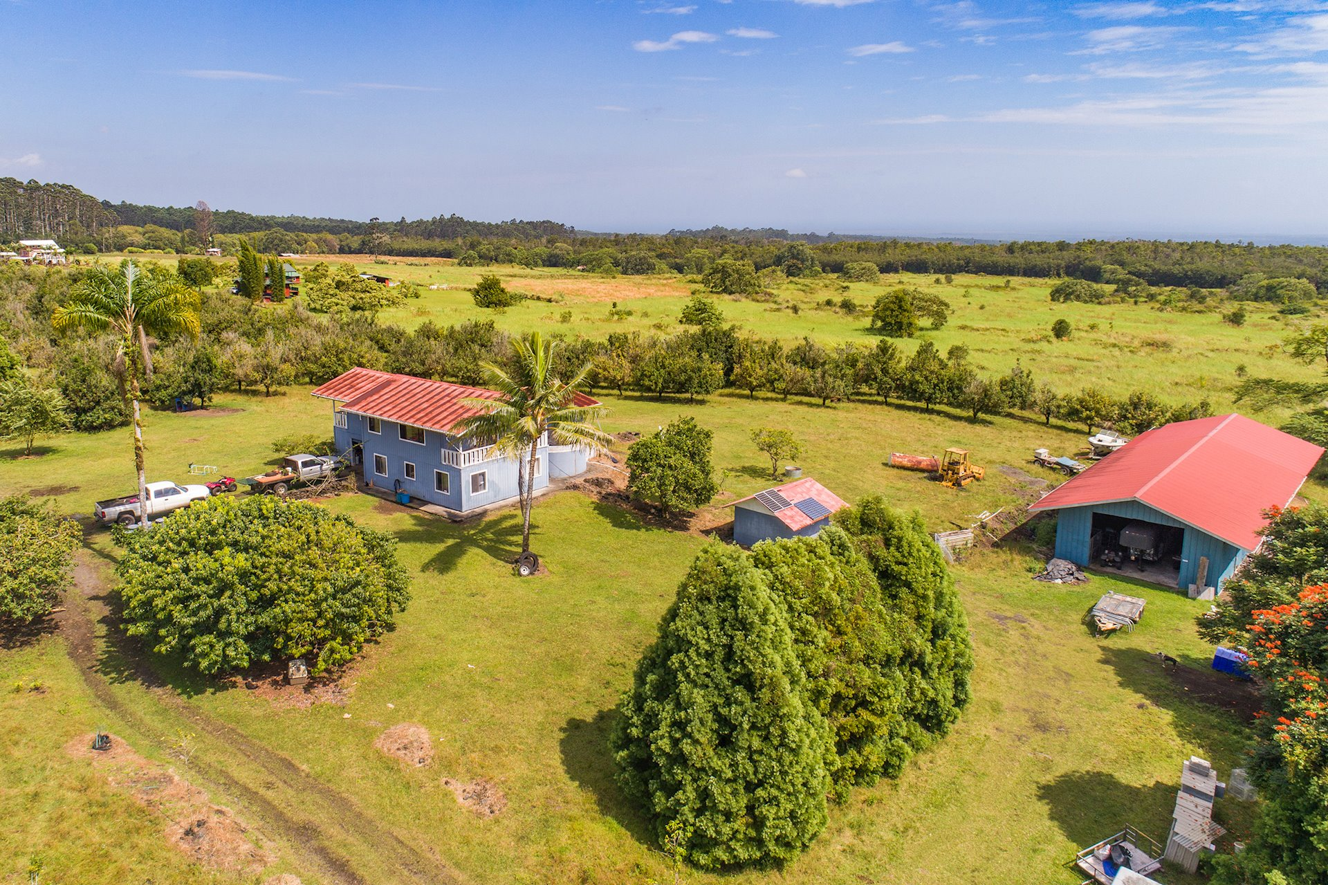 Incredible opportunity to own a huge piece of paradise in a private, quiet location. This property includes over 64 acres of macadamia nut trees, completely fenced, plus a barn.<br><br>A quiet country lifestyle awaits in the two-bedroom, two-bath home with ocean views and vaulted tongue-and-groove ceilings. Sit on your covered lanai and enjoy the peace of your lush surroundings, which also include ohia, palm, and Norfolk pine trees. Possible subdivision with A-20A zoning.