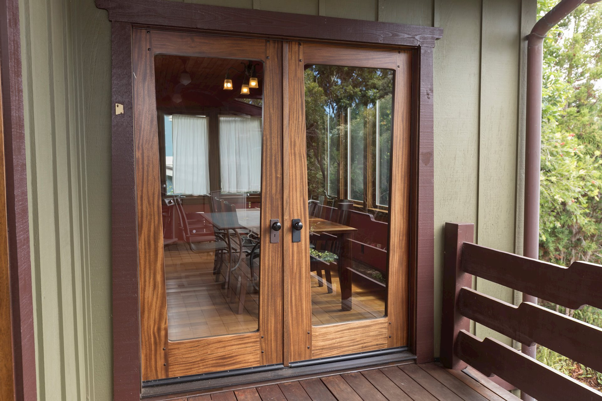 Custom Mahogany doors, window frames and baseboards throughout the home, garage and work shop.