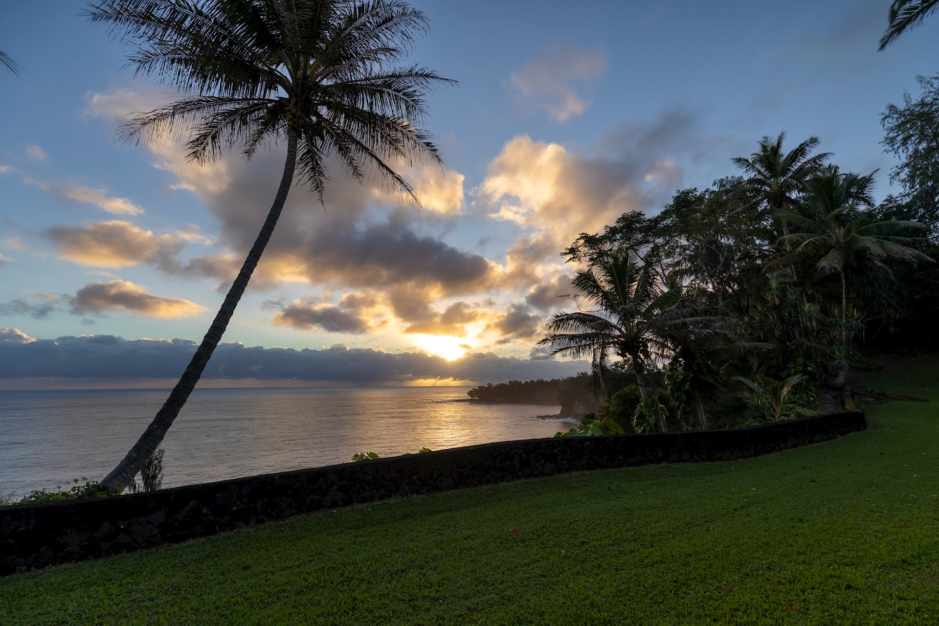 """Sunrise over the ocean. Ocean views look to Pohakunanu Bay and locally known surfing sites called """"Ladders"""" and """"23 Flats""""."""