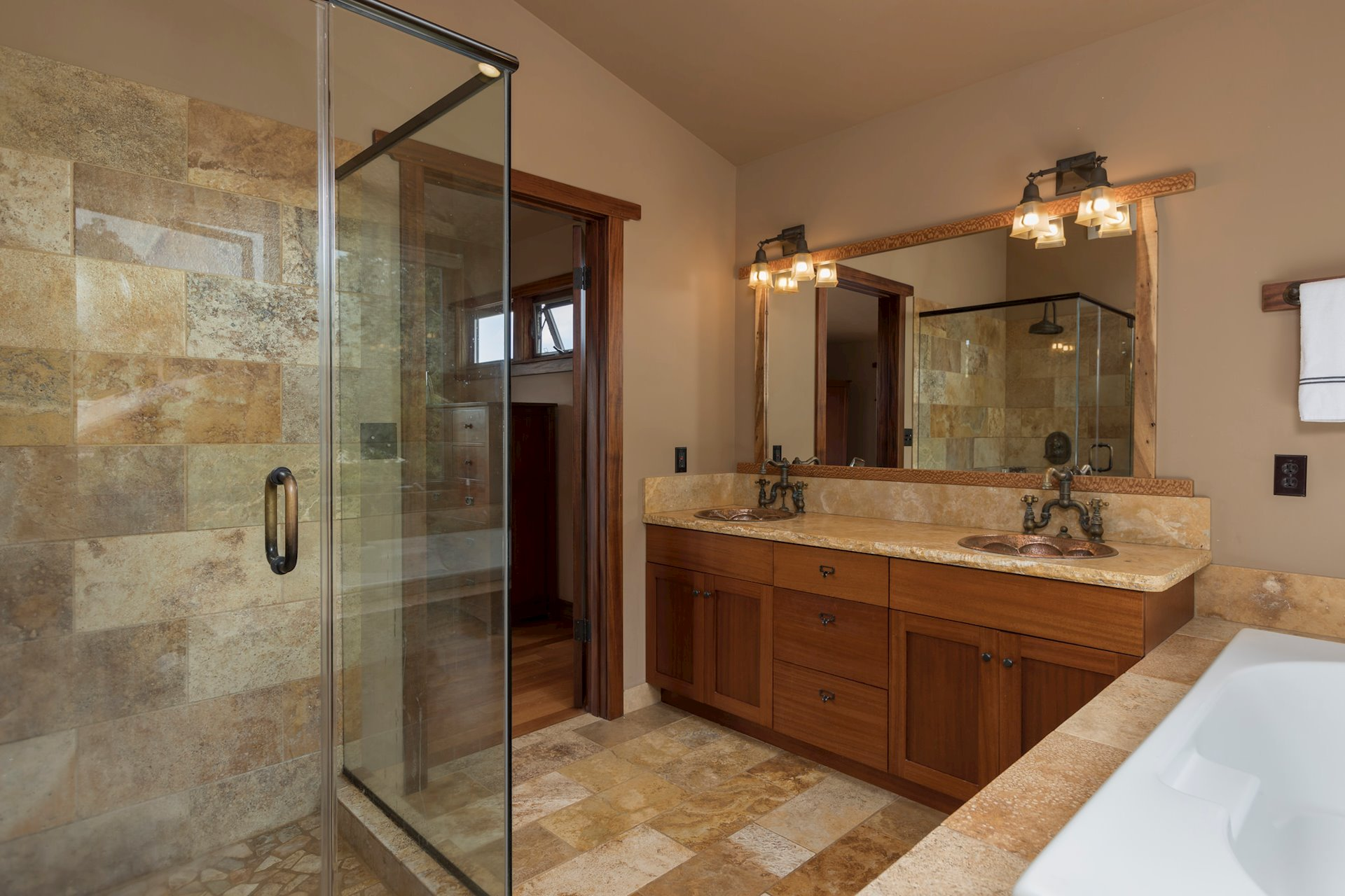Master bath with walk in shower, tub and double sinks.