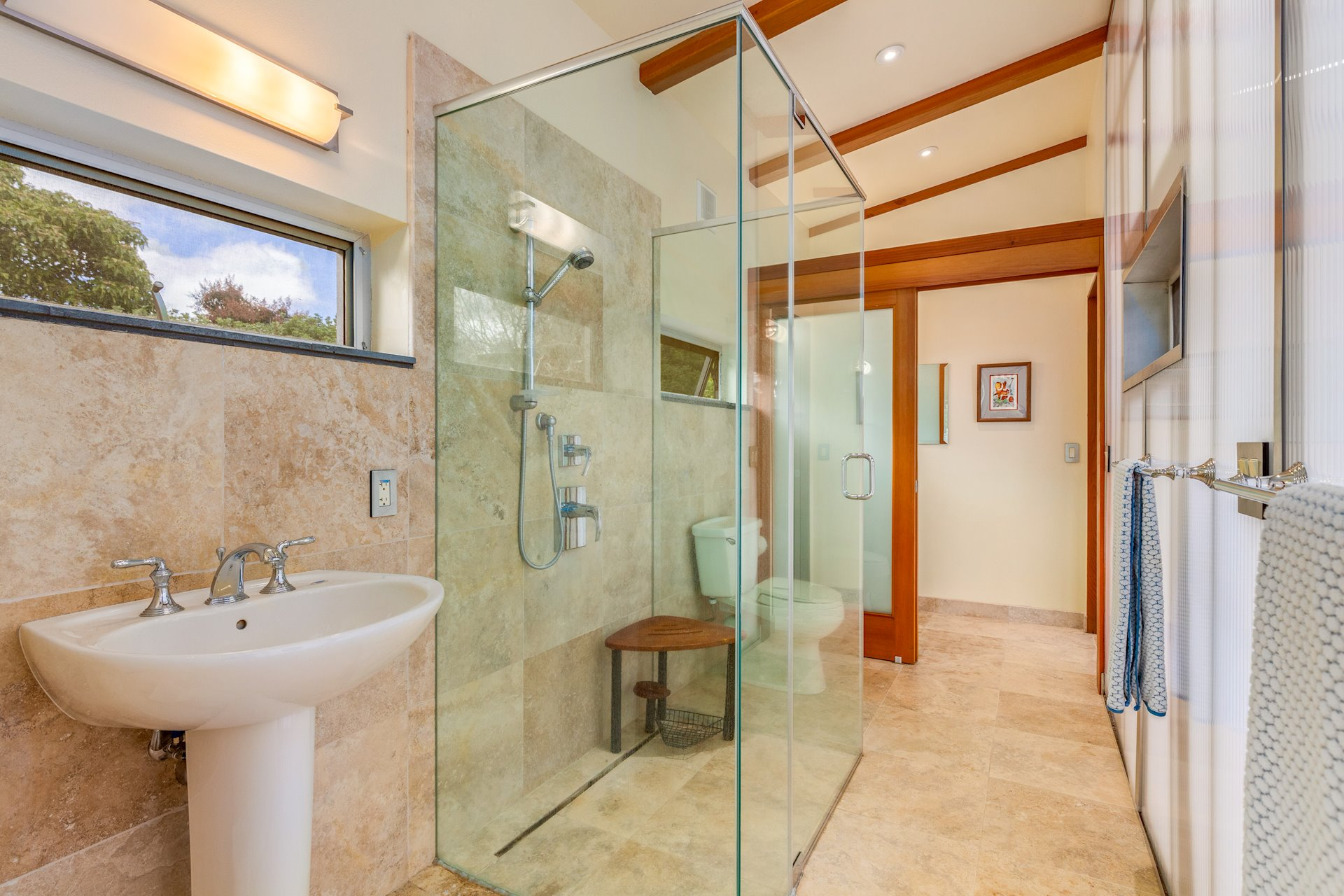 Guest bathroom separates the two rooms