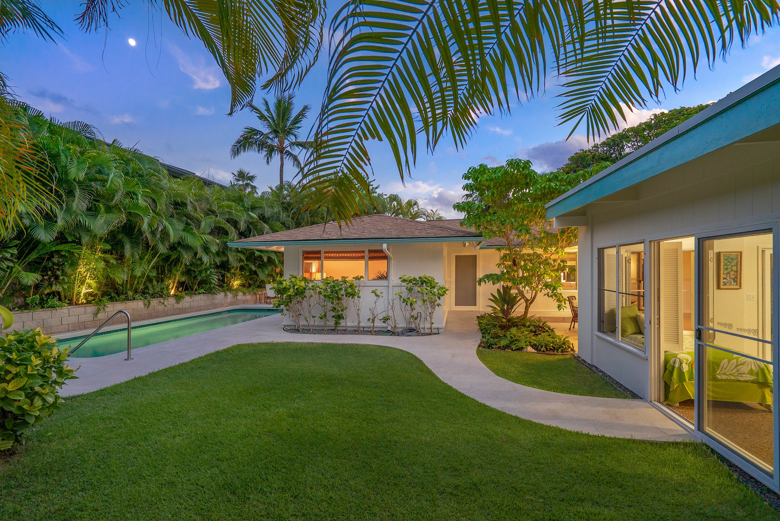 This Kailua Hale, one block from the beach,  was expertly designed by Honolulu architect Robert Alexander Lazo and renovated in 2000. The home has ample gathering spaces to entertain and the level lot is set back with lush landscaping that maximizes privacy while you enjoy the pool house and spa. Thoughtful elements of this single-level home, like a walk-in master shower and a ramp to the pool, accommodate aging-in-place. Stay comfortable year-round with central and split system A/C offset by leased PV panels and solar hot water. This address affords the opportunity to join the private Kalama Beach Club one block away. See the tour at http://player.vimeo.com/video/373016154. Broker's Open Thursday, 12/12 from 10:00 a.m. to 12:00 p.m. and Sunday, 12/15 from 2:00 p.m. to 4:00 p.m.