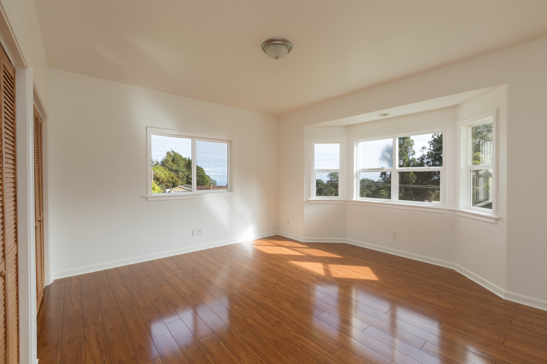 This is the second bedroom of 3 in each house. Lots of windows allow for natural light.