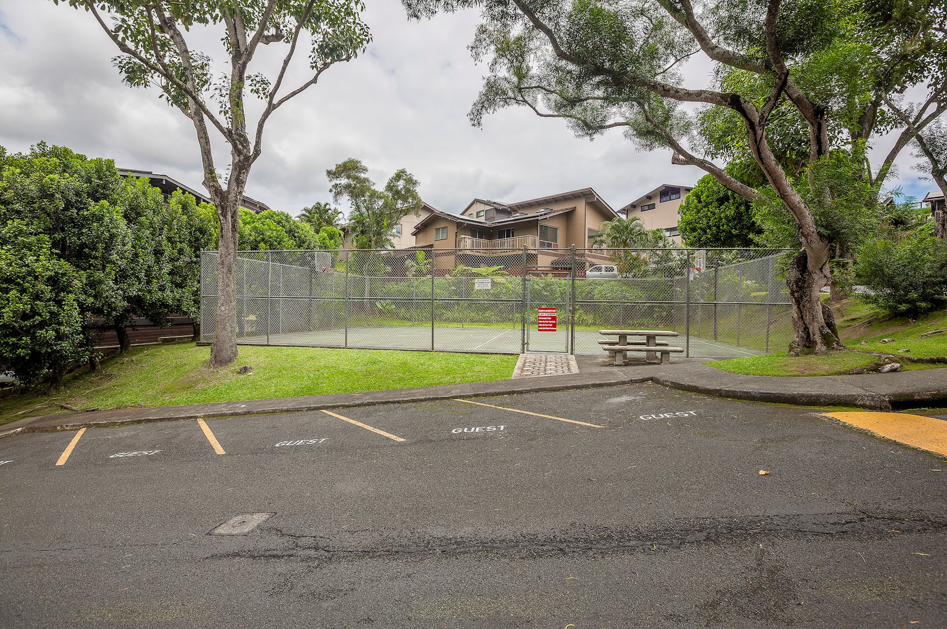 Common area, basketball court & picnic table to the Kaneohe Woods neighborhood community.  There are 10 guest parking stalls.