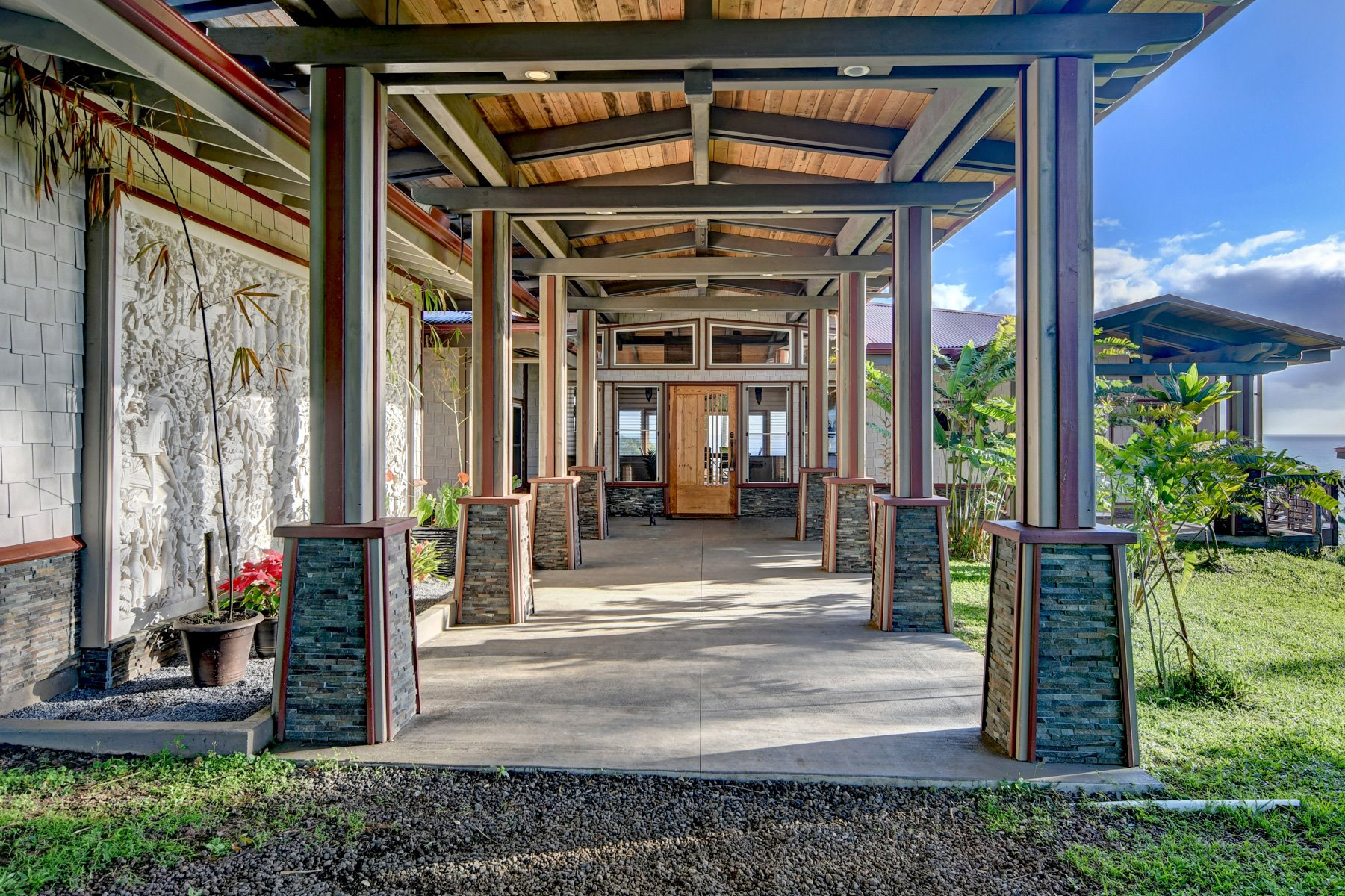 Entrance walkway into the main home as all of the entry aspects you would want in a home like this.