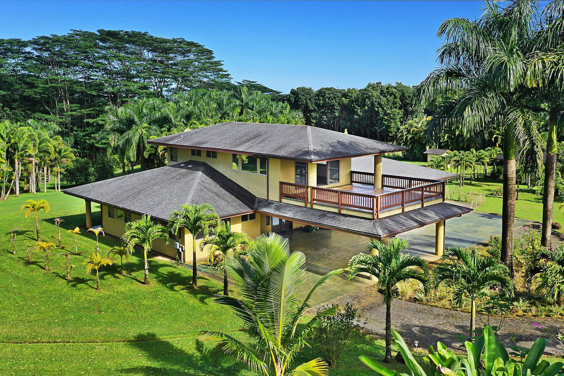 Kalihiwai Ridge Custom 3BD/3BA two story home (2446 sqft) on 5.5 acres zoned agricultural.   Built in 2006 designed with large open spaces, warm wood tones throughout, a chief's dream kitchen, and spacious living area opening to a large covered lanai surrounded with tropical landscaping providing the ultimate privacy from neighboring properties.  The master suite consists of the entire second floor exiting to a tiled deck over the port-de-chere framing the soaring Namahana mountain range.  Guest bedrooms and baths have their own wings off the main living area on the first floor.  Property has  horticulture areas including citrus, avocado trees, and commercial palm trees.  There is an area used in the past for hydroponic gardening.  Energy efficient with propane dryer, water heater, and stove plus most windows have been tinted.