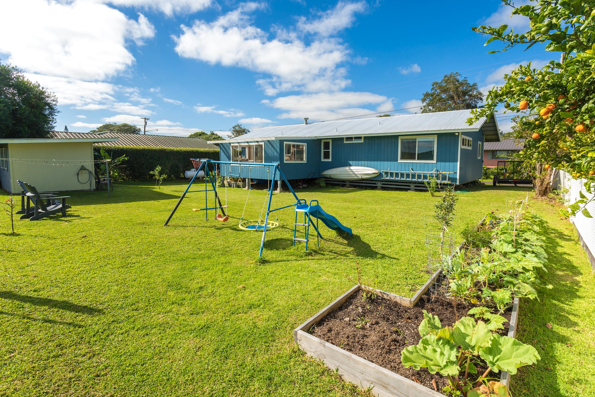Large back yard with Raised Garden Beds and External Office/Art studio/Yoga space