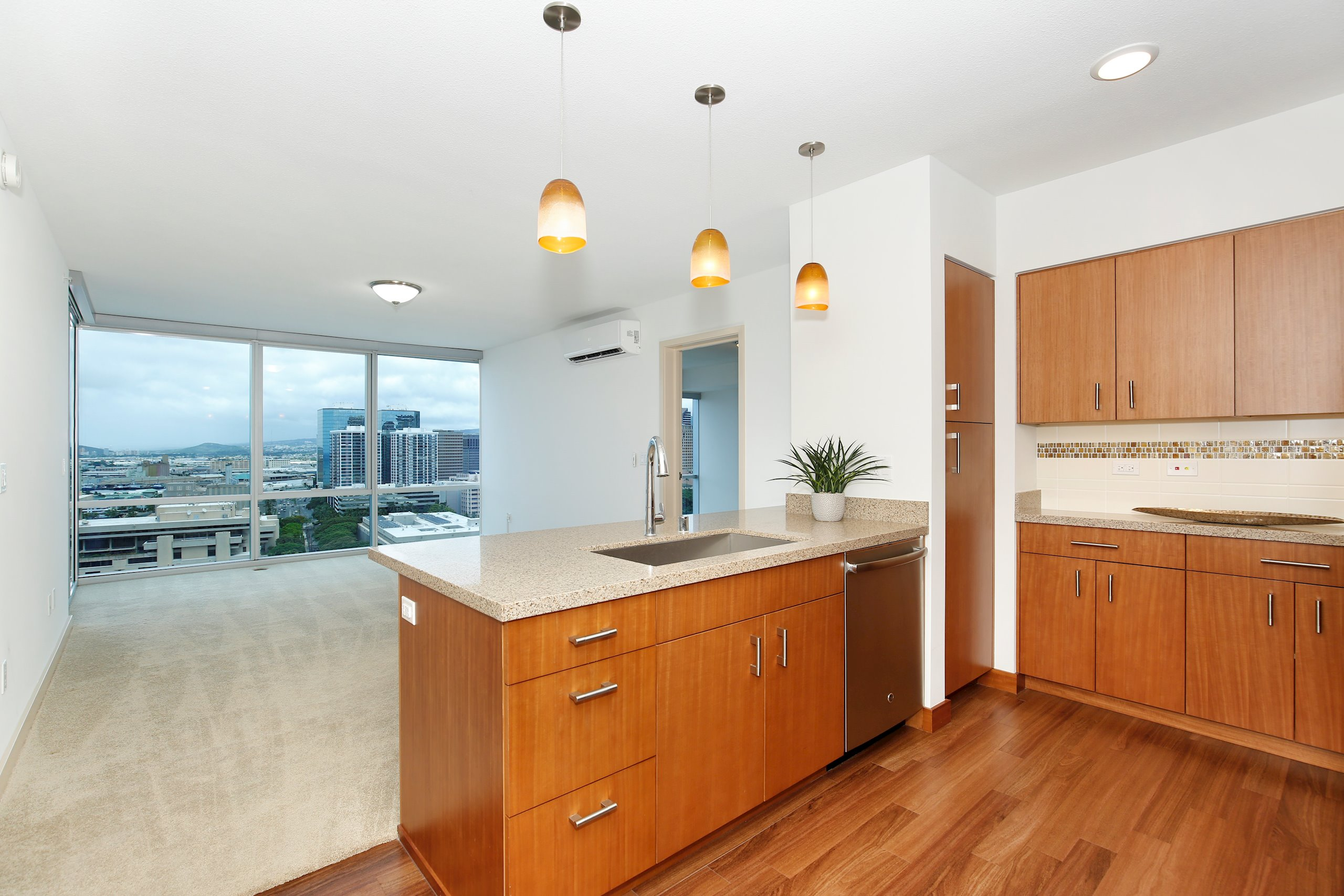 "You'll love the spacious feel of this large, preferred ""07"" stack condo with 999 square feet plus a 75 square foot lanai! Floor-to-ceiling double glazed insulated Low-E windows show off the open unobstructed views of Honolulu Harbor, the Downtown skyline as well as the ocean and mountains. The elegant contemporary design of the kitchen will impress you with quartz counter tops, stainless steel appliances and European style Anigre wood cabinets. Energy saving appliances, split AC units, individual water heaters and EV charging stations add up to energy savings. You'll love the electronic automated shades which also feature black out shades in bedrooms. The spacious recreation deck and well-equipped fitness center are on par with amenities you come to expect in a luxury high-rise condo built today."