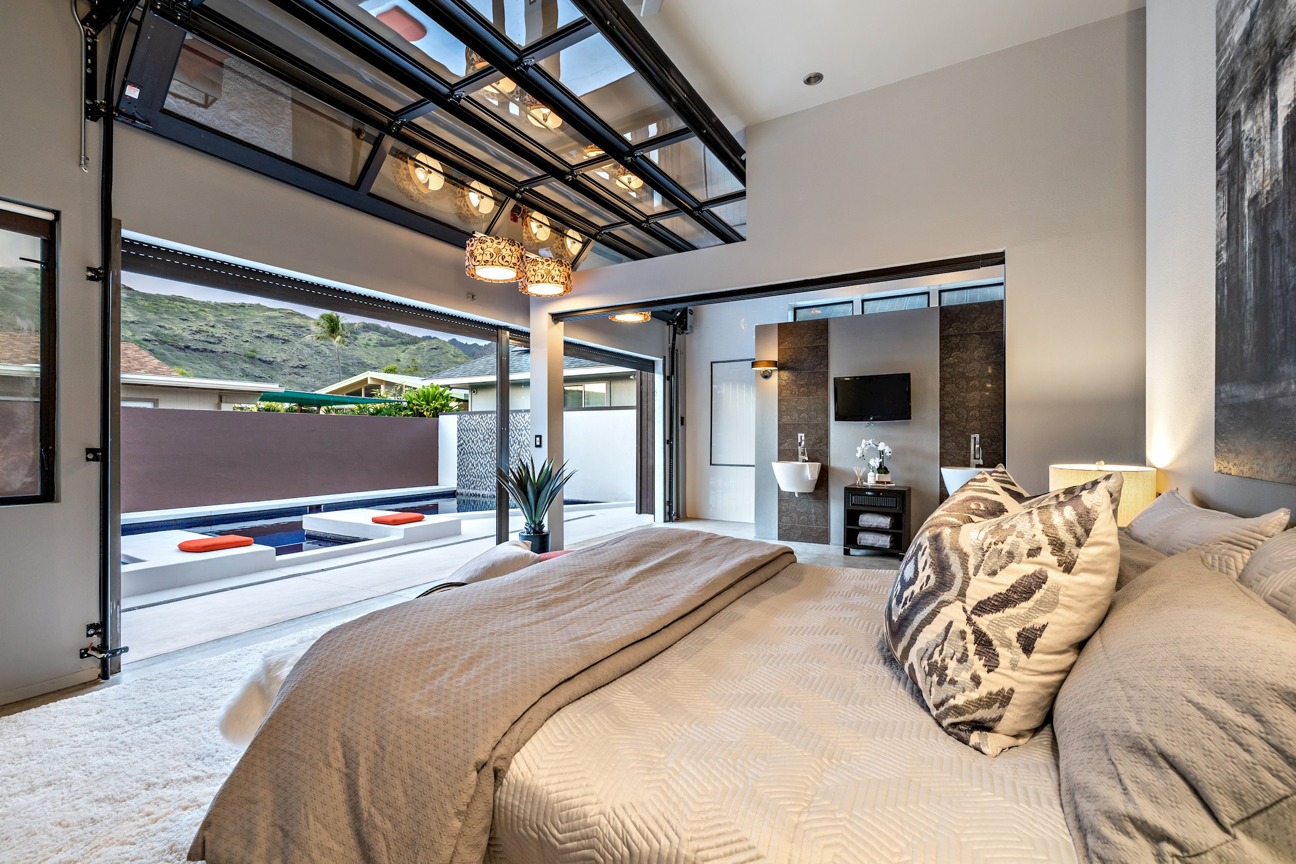 Master Bedroom looks out to pool. Sit by the pool and enjoy a night cap before bed.