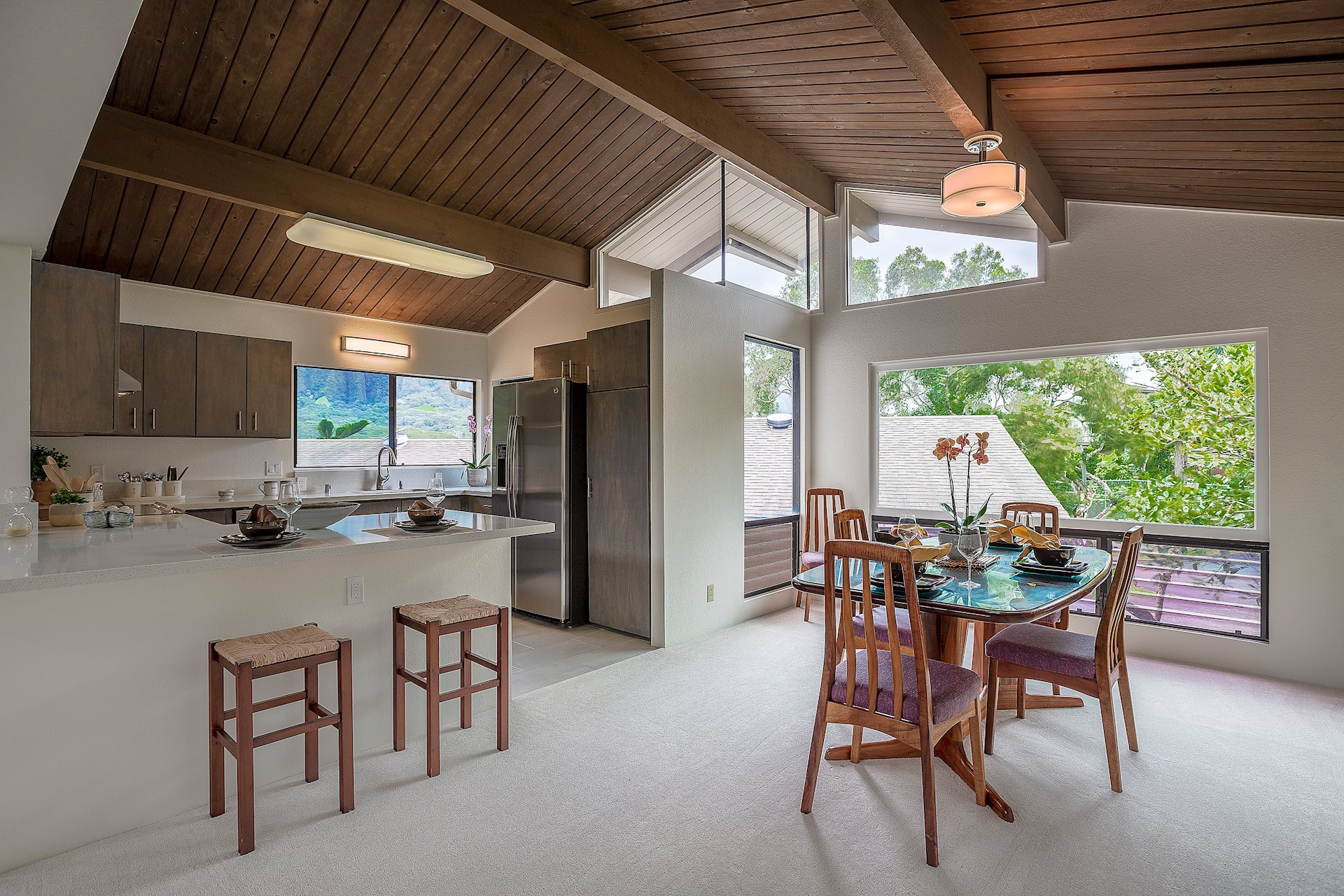 The dining sits off the kitchen with large windows and bright lighting.  Beautiful architectural lines in this home.