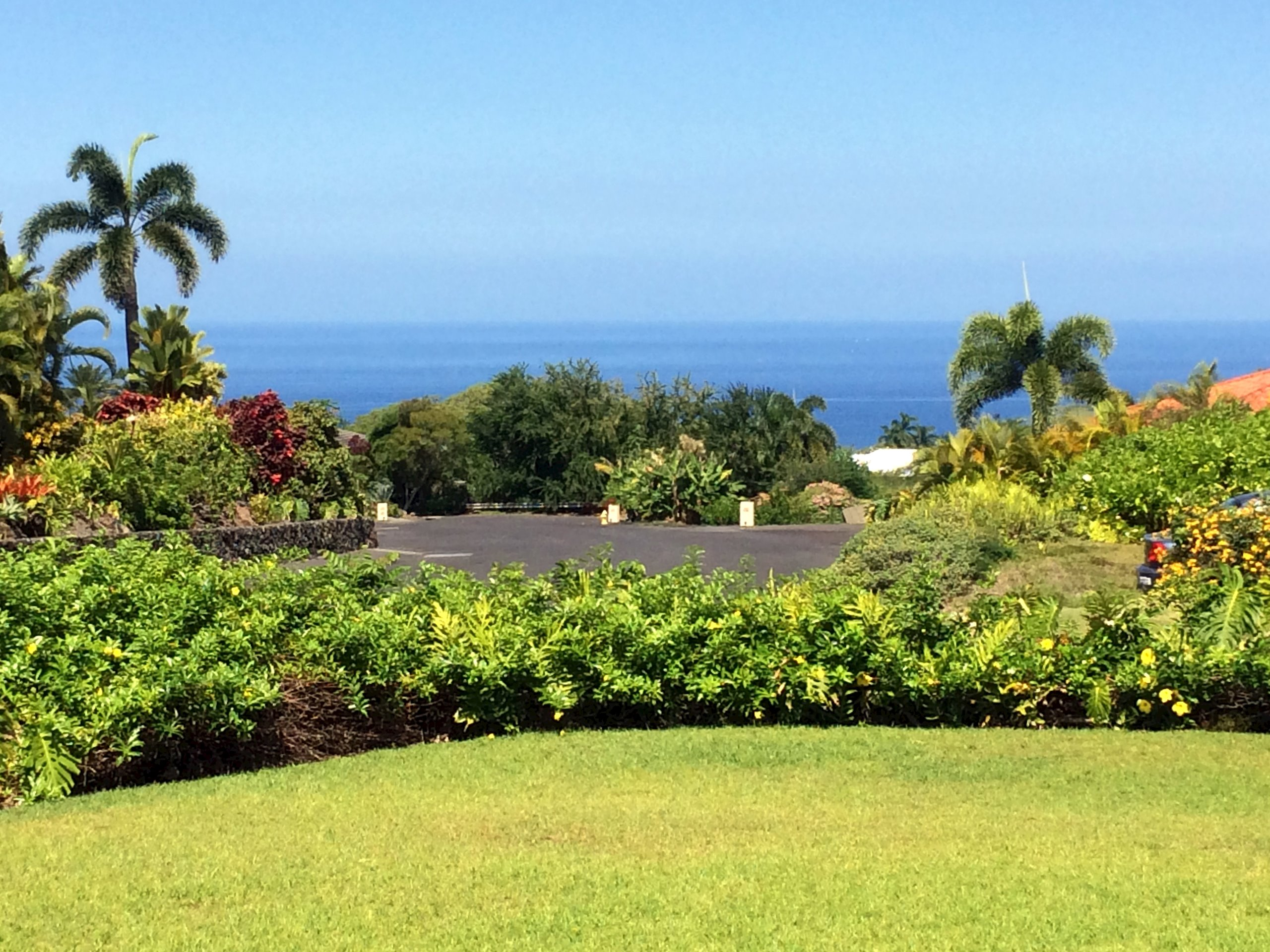Beautifully landscaped lot with rock walls and ocean views - ready for your Hawaii vision.  Easy to build - level lot - beautiful plantings and rock walls.  Located in a tropical neighborhood of luxury homes<br>above town and just 5 minutes from restaurants, the Pier and downtown shopping.  Close to golf and ocean activities.  The subdivision minimum size is 1200 sf with stucco exterior and tile roof.<br>This is a gated Tennis Community with two well maintained Tennis Courts - located in the Holualoa School District.