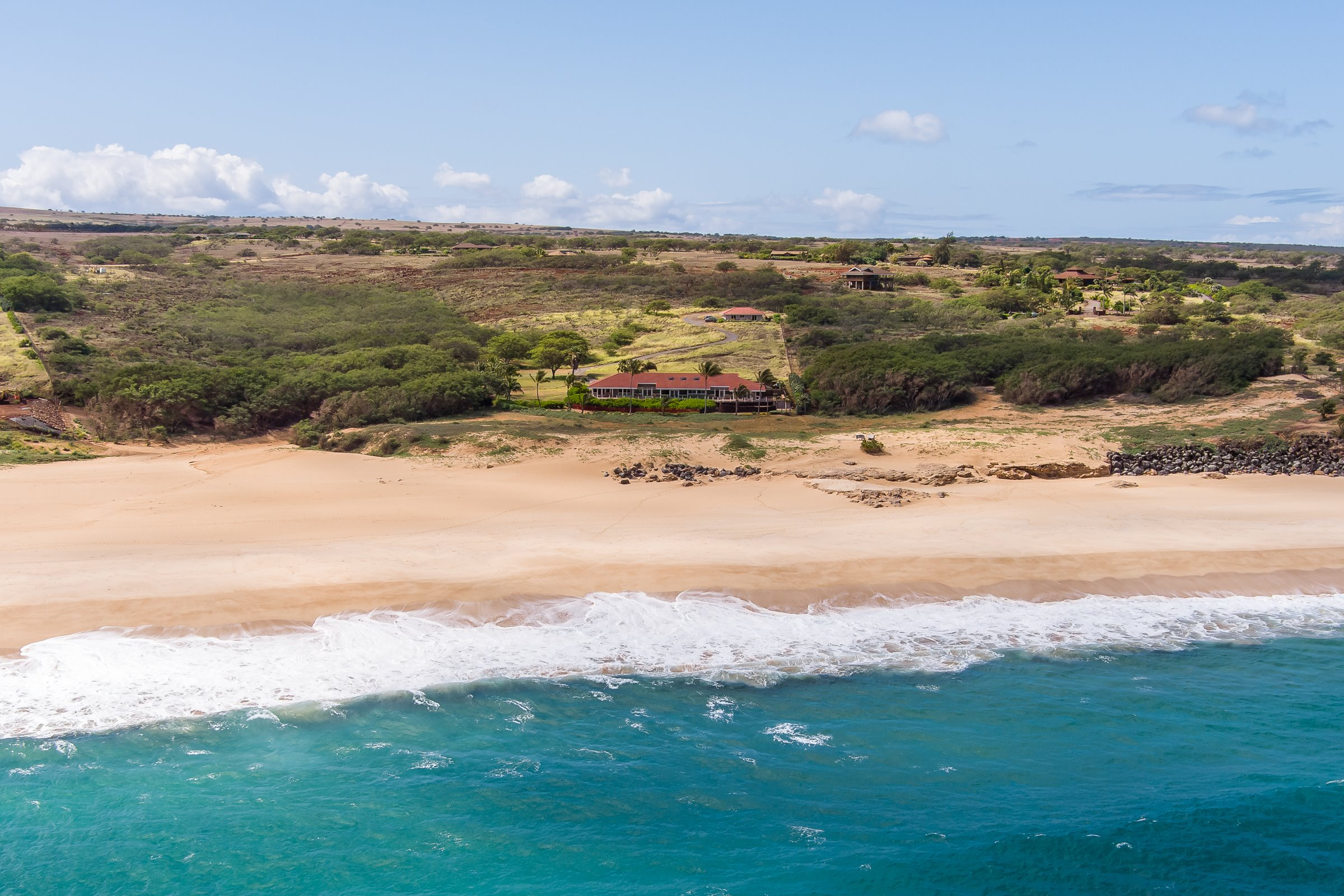 Endless views of Molokais famed Papohaku Beach grab you from almost every room of this classic, modern beach house. The 6 acre privat...