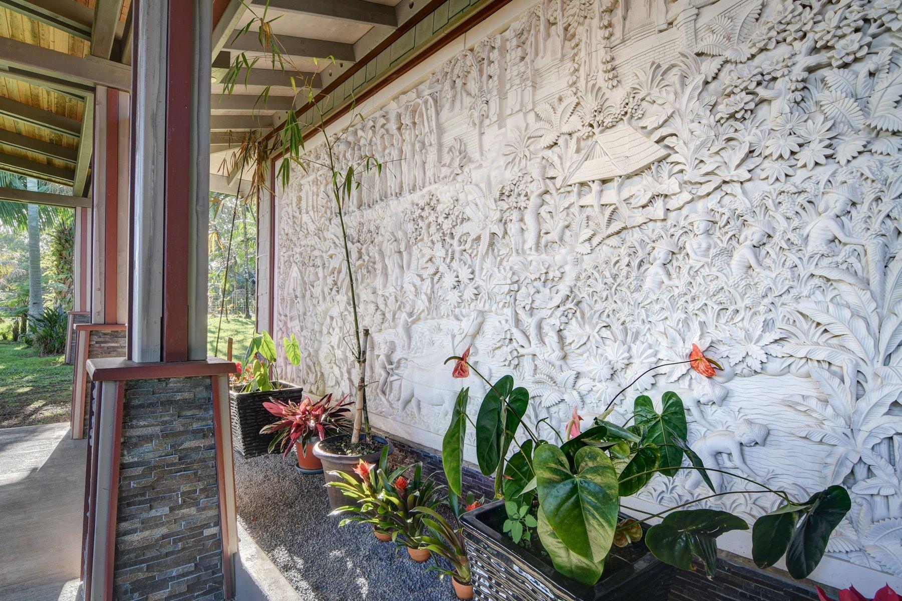Custom Balinese carved stone mural wall.