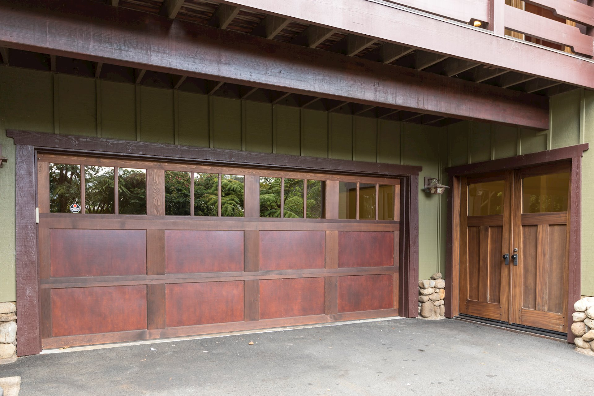 Extra deep 20'x24' 2-car garage with 7 ft. by 16 ft. cedar and mahogany door; workshop is the door to the right.
