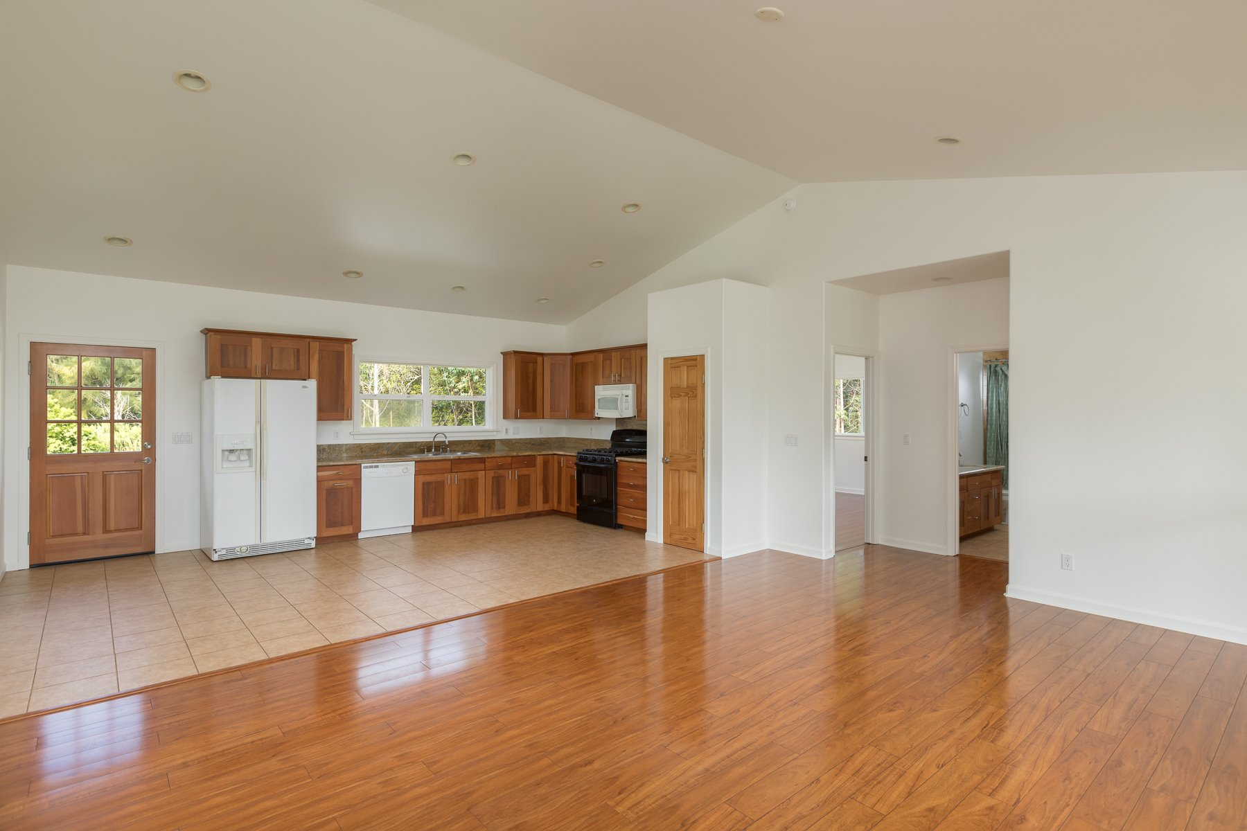 Kitchen meets the large living room; all natural light. Newer construction is rare to find Island-wide today and especially in this desirable low-density area of the Hamakua Coast.