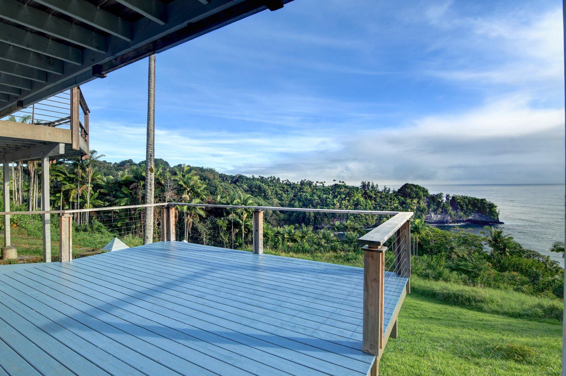Bottom floor recently installed yoga platform and wrap around deck.