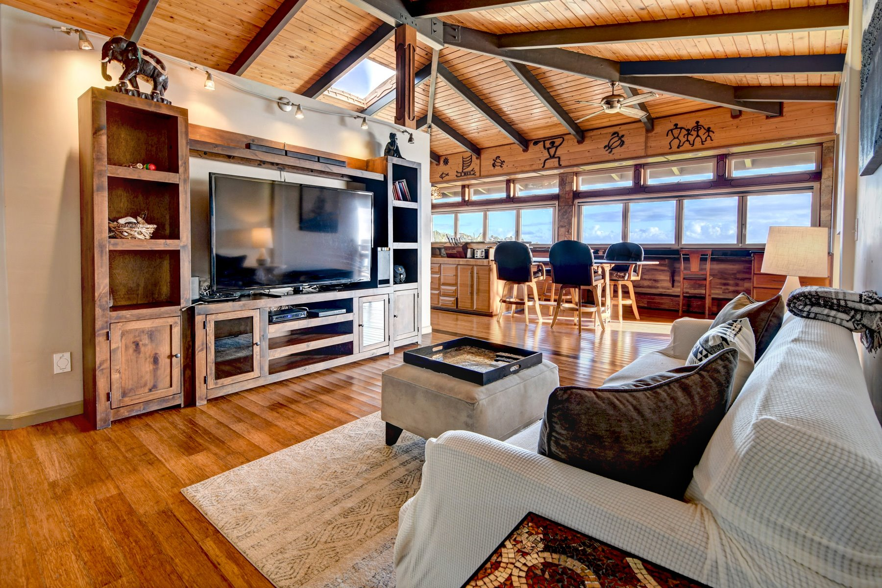 This entertainment room is attached to the kitchen and also offers incredible views.