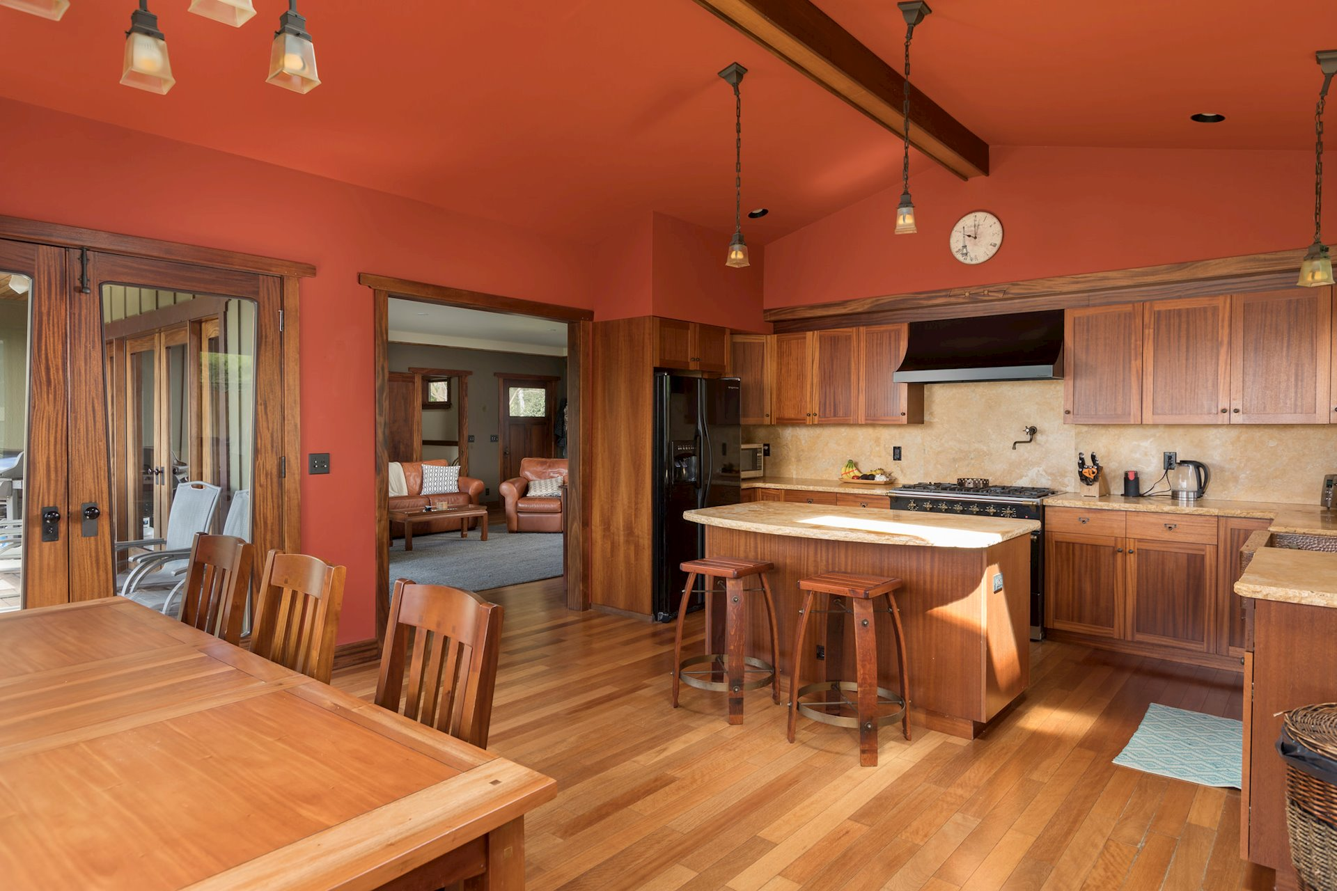 The flooring is engineered and the finish is solvent free, the wood species is Asian mahogany.