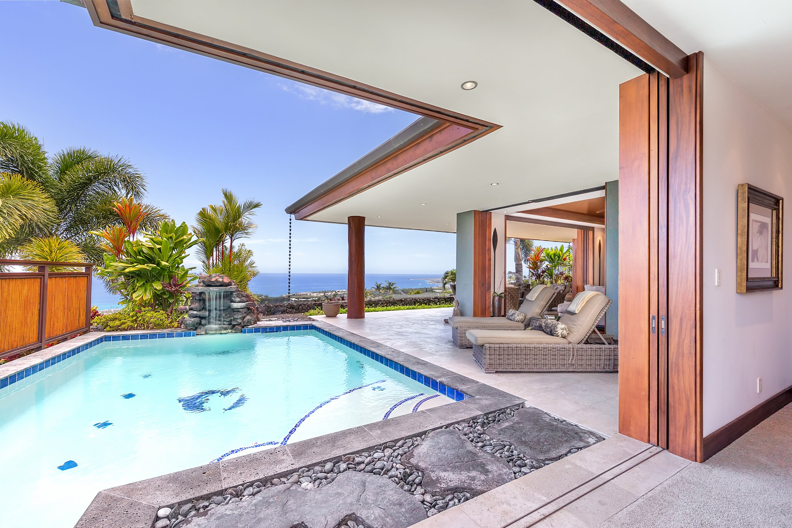 "STUNNING CRAFTSMANSHIP AND SYMMETRY IN THIS EXTRAORDINARY LUXURY KONA HOME<br><br>Situated on a picturesque lot in the prestigious Kona Vistas neighborhood in Kailua-Kona, this one-of-a-kind luxury estate home boasts incredible architectural details, not to mention one of the best 180-degree ocean views in Kona. Showcasing dramatic geometric angles and a very striking floor plan this home shines like a jewel with impeccable Hawaiian accents and exquisite interiors throughout. <br><br>This eye-catching masterpiece was designed to impress even the most discerning buyer. As you step into this gorgeous home, the open-air foyer brings the outside in, accented by stately 'ohia post and glass cathedral prism skylights. Noticeable Feng Shui in the entrance with double etched glass doors welcomes you in. <br><br>The property's surrounding landscape and spacious lanais bring an aesthetic contrast with Mahogany cornerless pocket doors combine to create a peaceful enclave that provides private, abundant indoor-outdoor island living space suitable for extravagant soirées or for enjoying quiet sunsets and unobstructed ocean views with family and friends.<br><br>This EPIC Home features two identical master suites each with expansive loft bonus space for many different uses, both flaunting incredible tranquil spa-like bathrooms with private outdoor showers. Perfect for entertaining, the gourmet kitchen is beyond impeccable, you immediately take notice of beautiful Monkeypod cabinets, locally sourced, that complement the Cactus Borealis granite slab and top-of-the-line appliances.   Unique separate guest quarters include 1 bedroom, 1 full bath, kitchenette and media room which offers ideal living space for extended stay guests or family members.<br><br>Swim laps in the resort-style saltwater pool with dolphin and turtle inlays and a cascading lava rock waterfall.  <br><br>Previously featured in the ""At Home"" magazine, this is one of the best homes on the market."