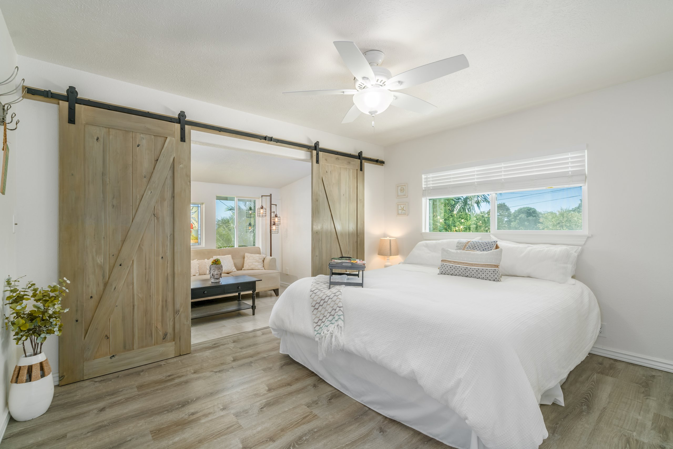 Upstairs master with custom stained indoor barn doors.