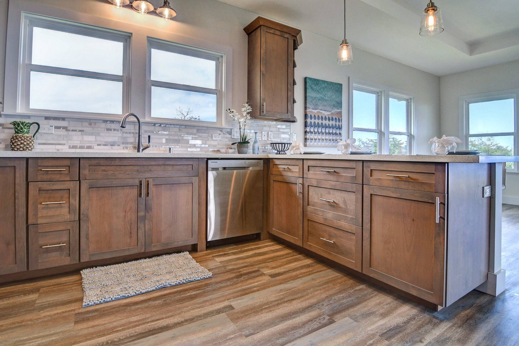 High quality custom cabinetry, all stainless appliances, and custom high quality quartz countertops. Propane appliances and solar hot water.