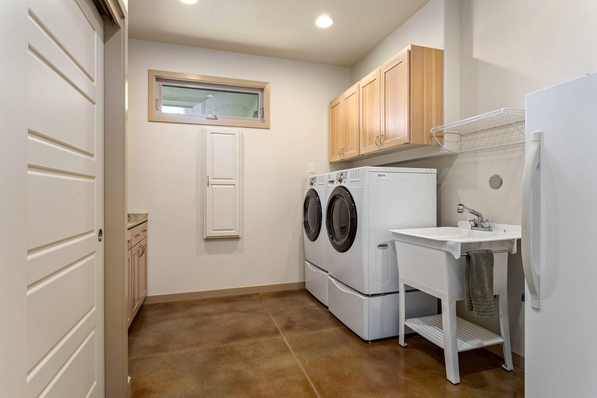 Large laundry room with plenty of storage