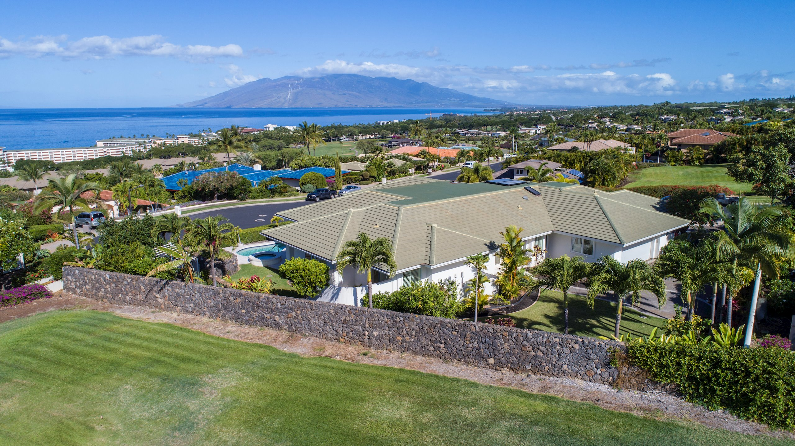 Located on the green belt in exclusive Wailea Golf Estates, this spacious home boasts three bedrooms & 4.5 baths. The home office may...