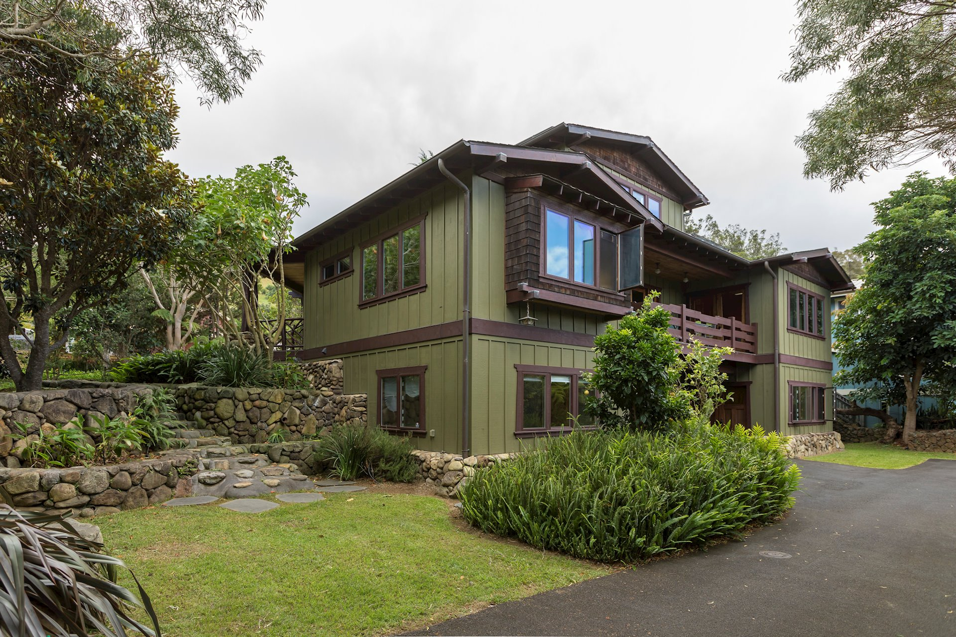 The look, colors and detailing of this home stands out and yet fits perfectly into the upcountry lifestyle of Waimea. Hand laid stone garden to the left in this photo.