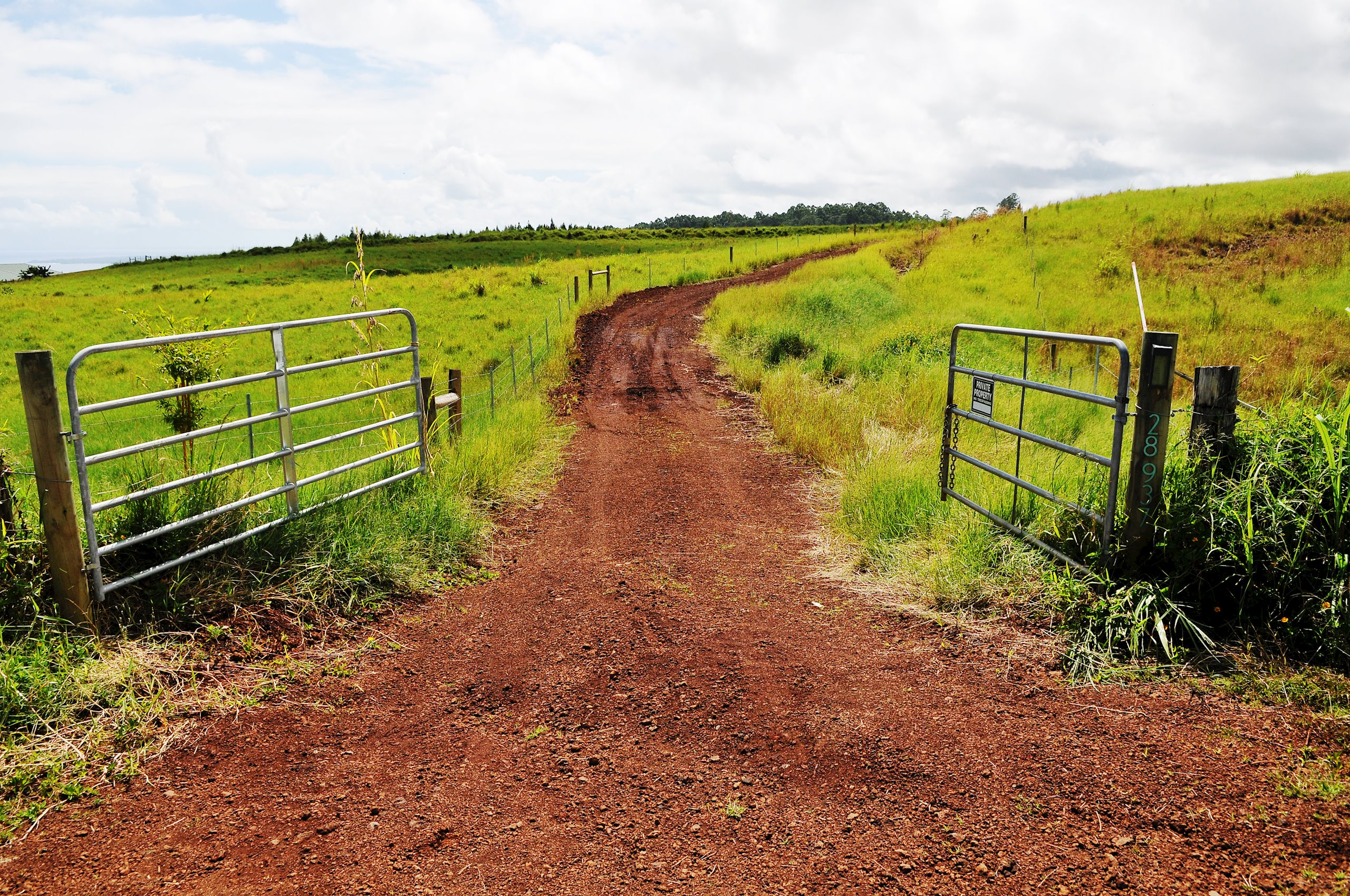 Private entrance driveway from paved County road