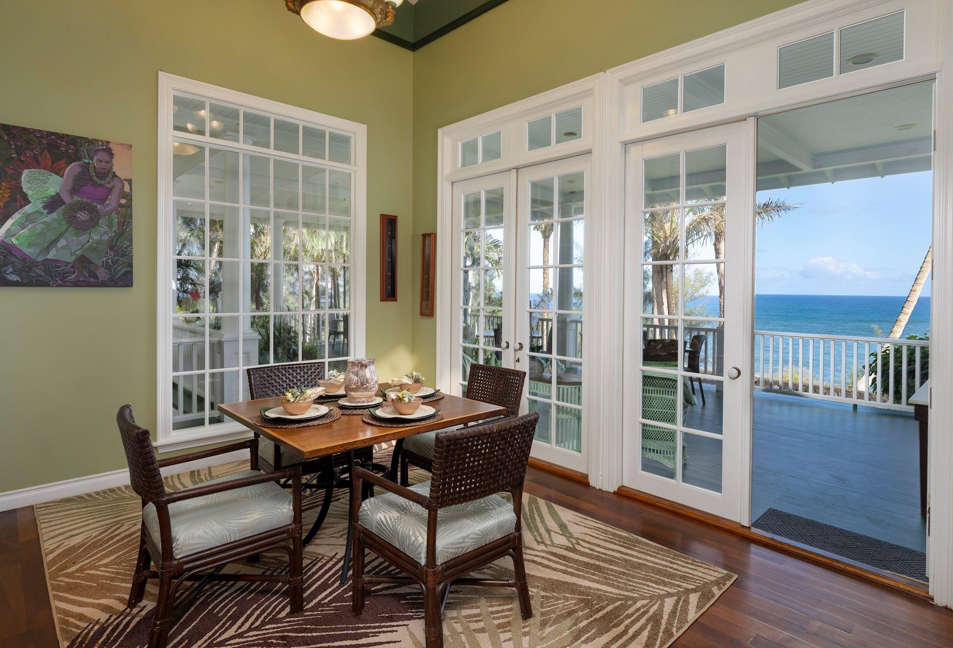Breakfast nook off the kitchen leads to a huge veranda.