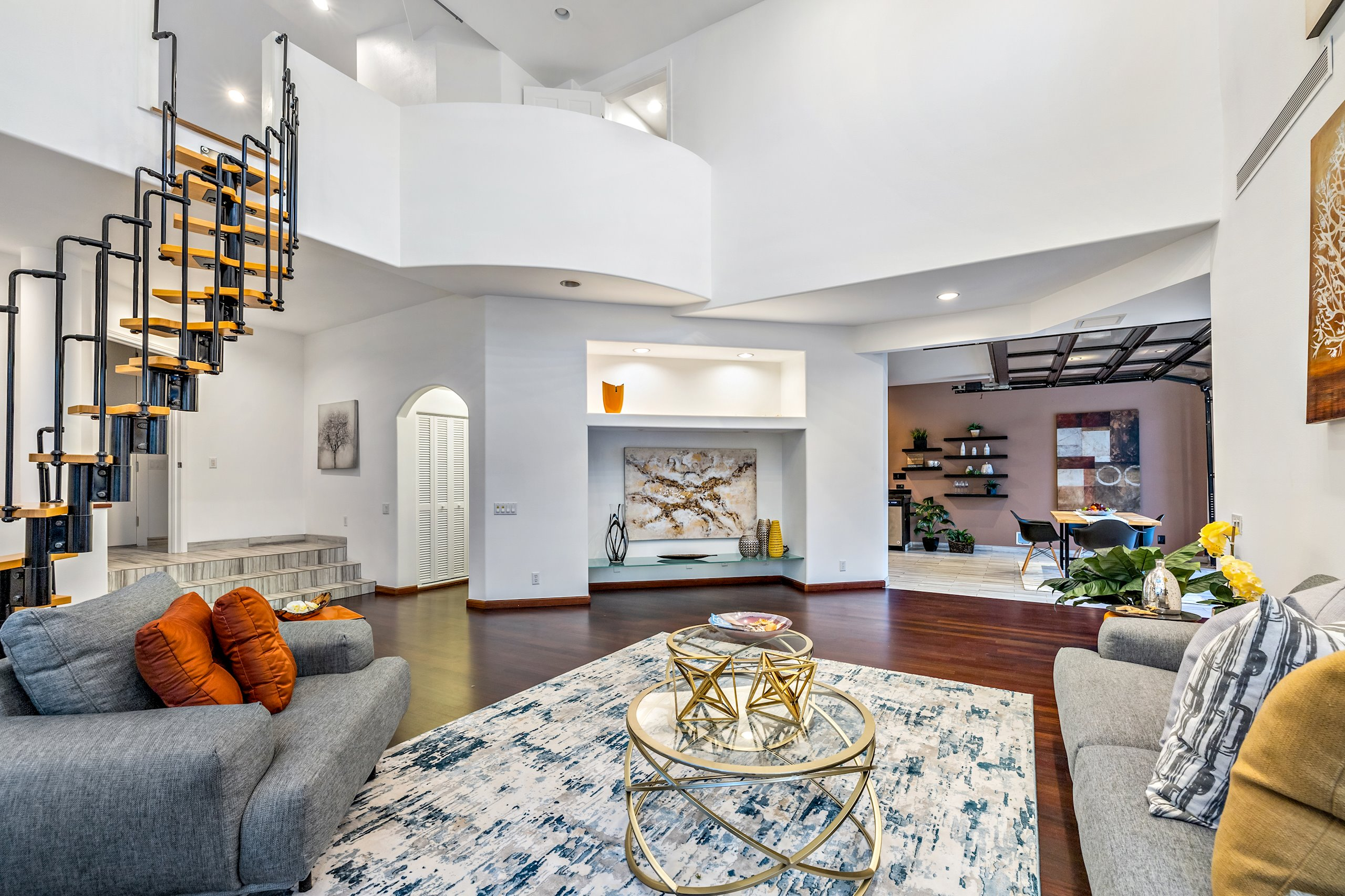 Living room shows loft and above and entrance to kitchen